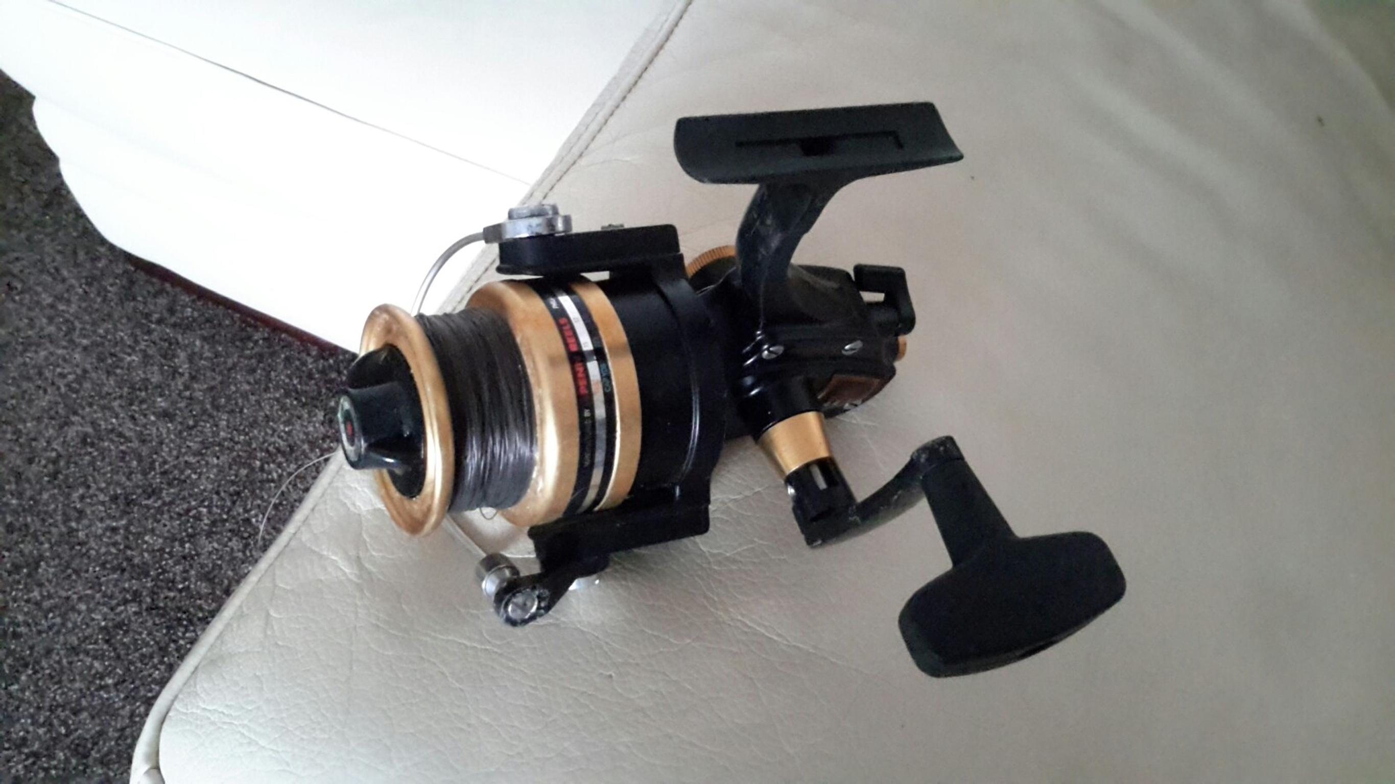 Sea fishing rod (beachcasting) and reel.