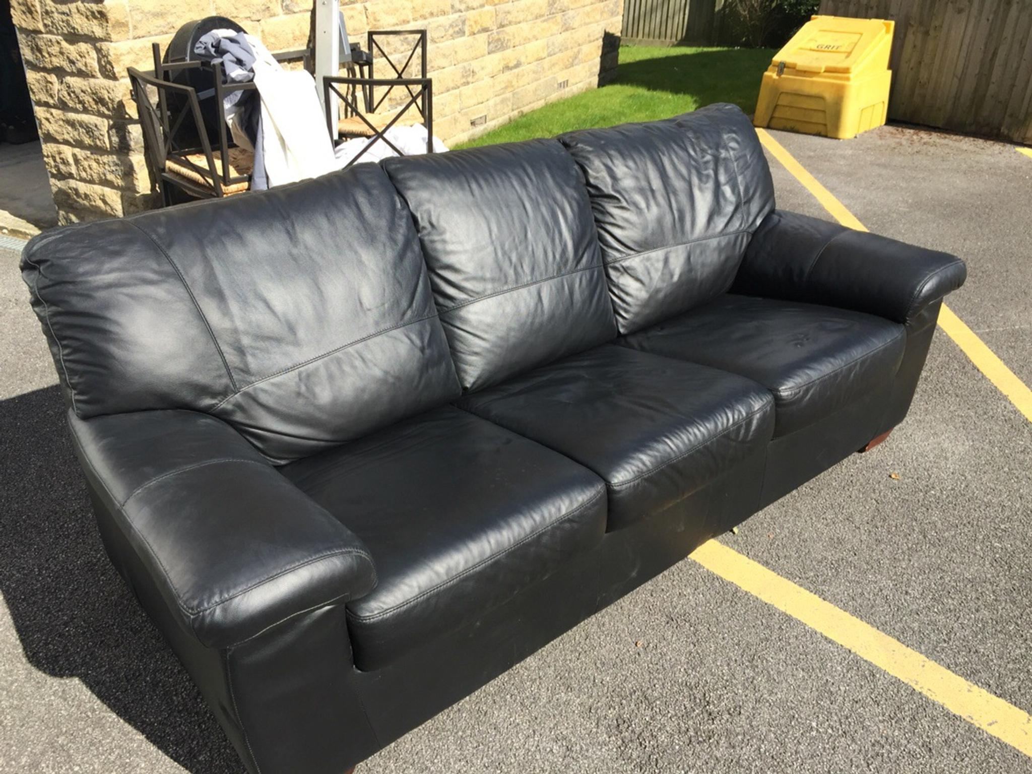 Black 3 seater leather sofa DFS