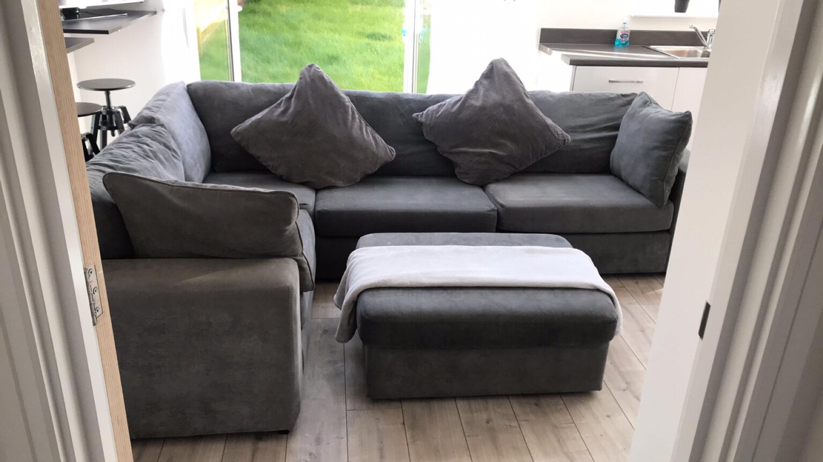 Grey contemporary corner sofa with foot rest