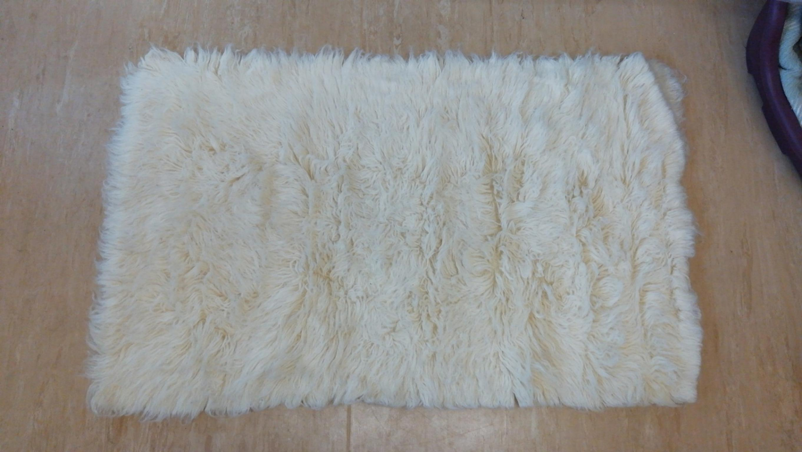 cream rug New with tags size 70x120 in