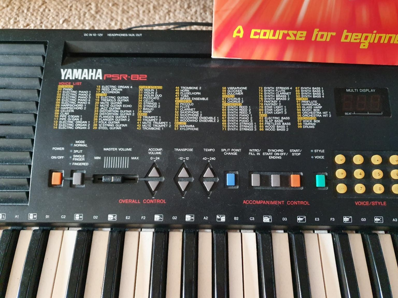 Yamaha keyboard with play piano book