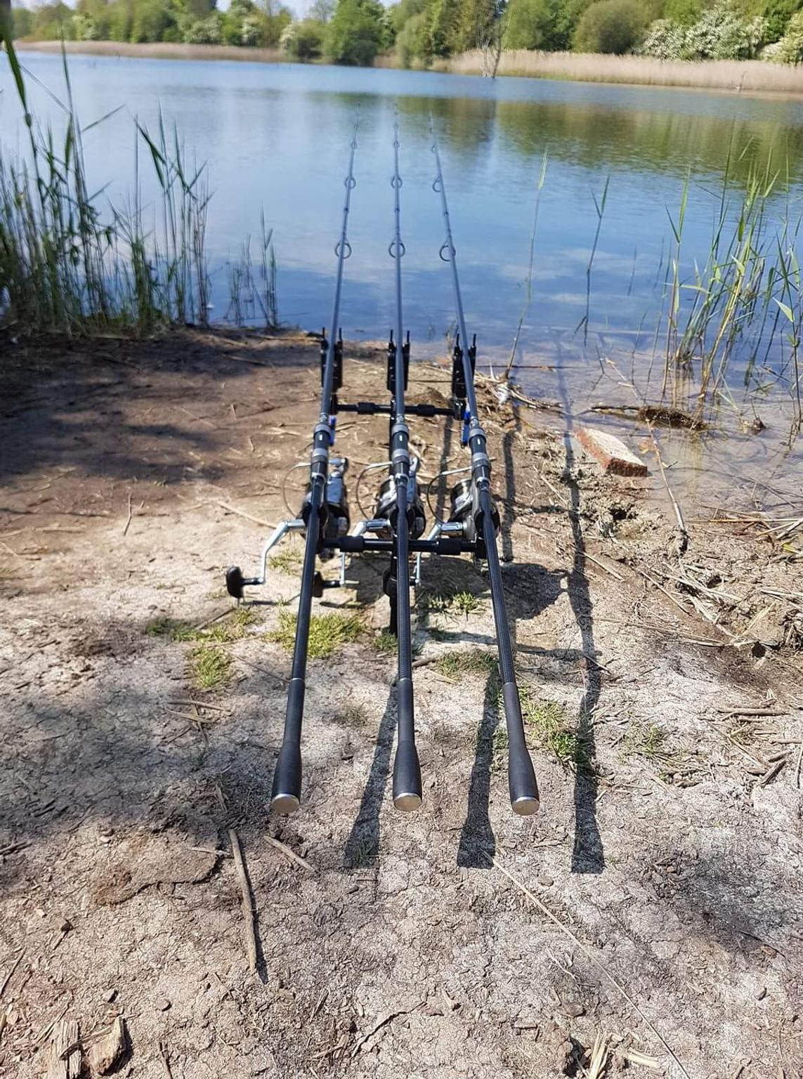Carp fishing. Rods on a rod pod with the swingers attached ready..
