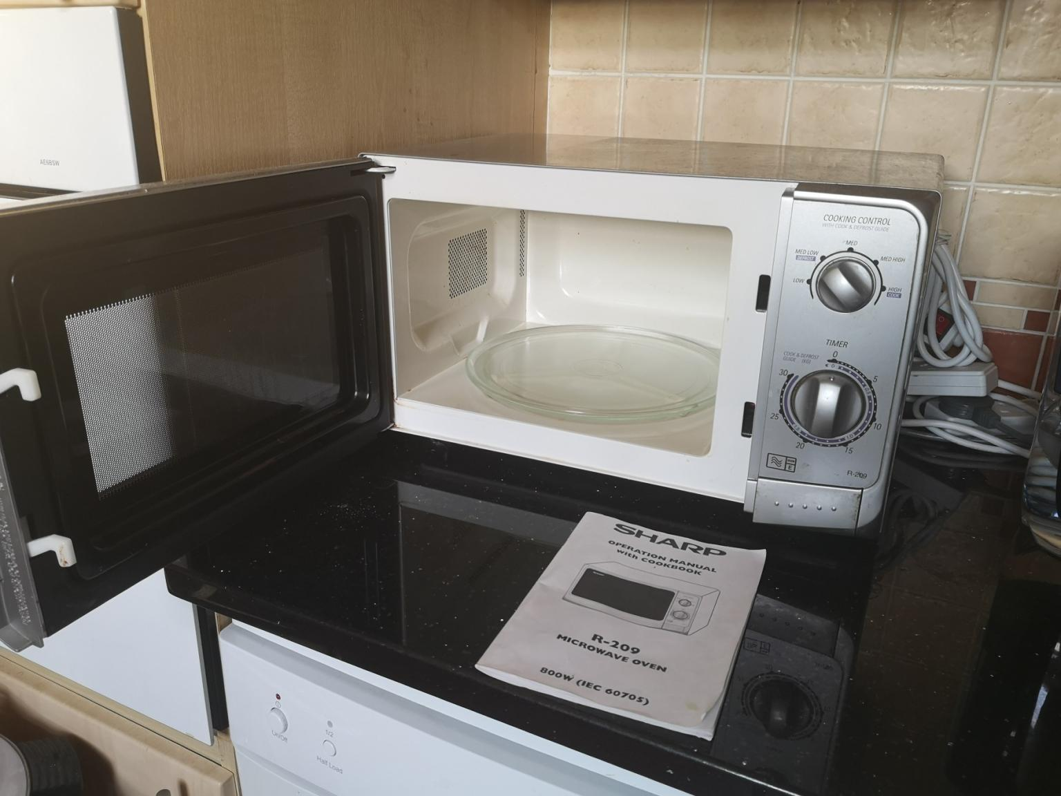 Microwave oven in SW19 London Borough