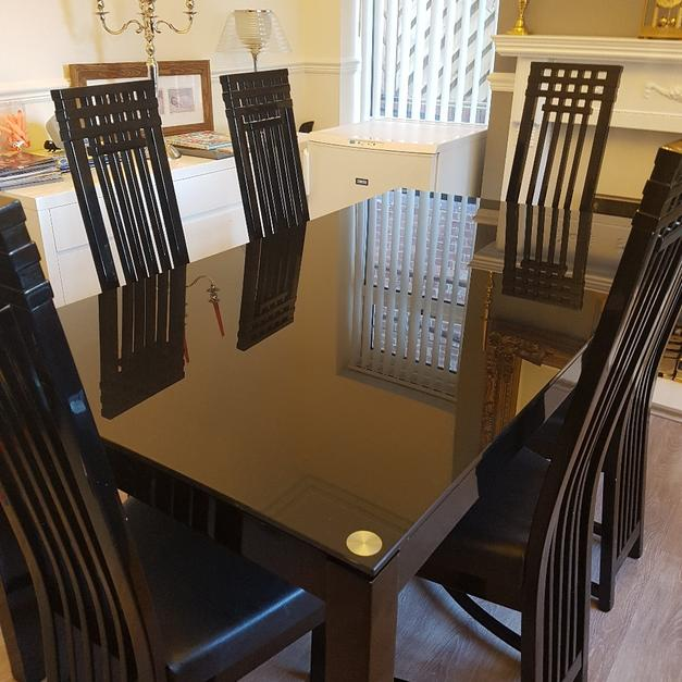 Description Black Dining Table And Six Chairs For Sale