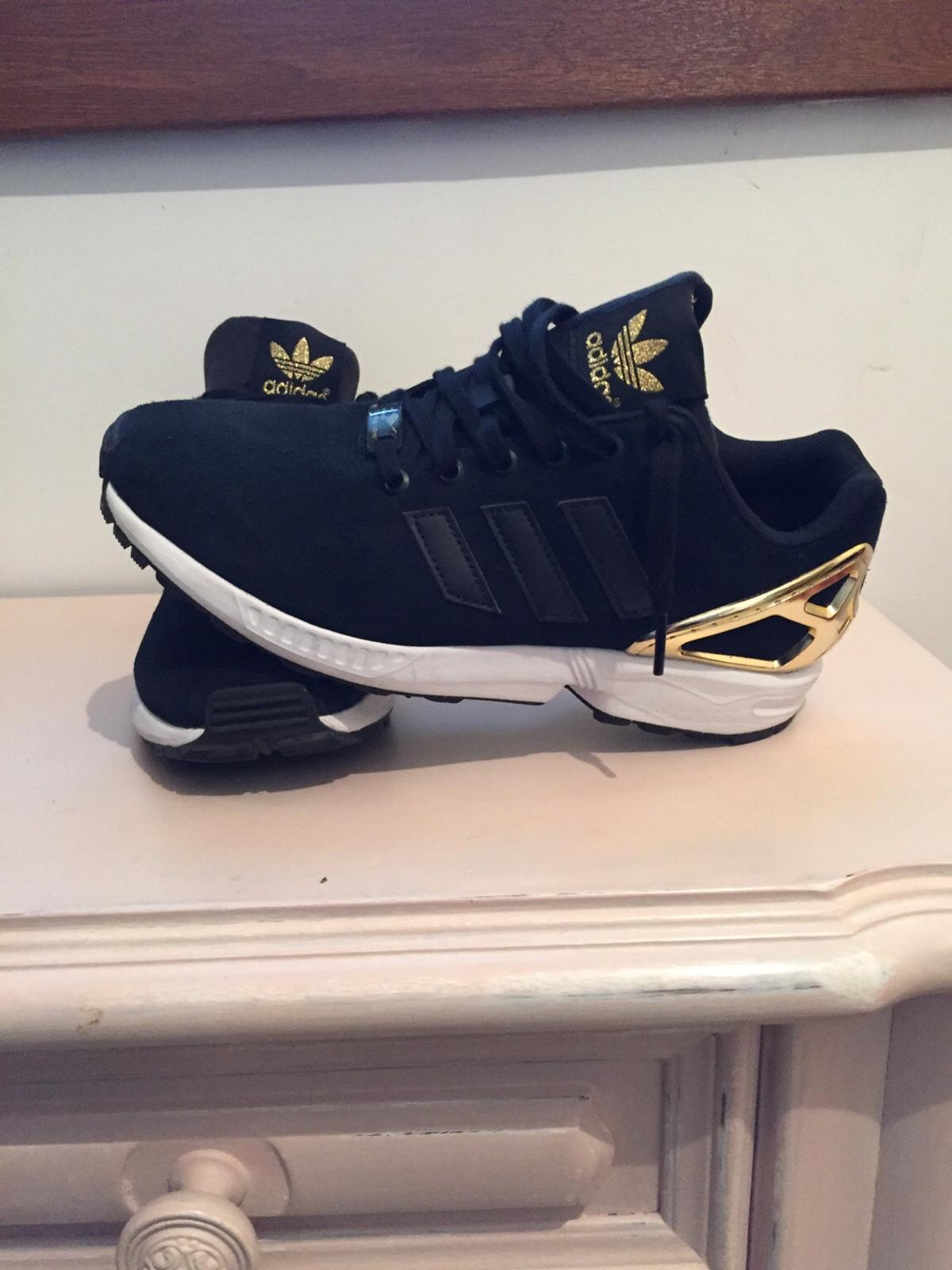 finest selection bbb49 7dca4 Adidas zx flux nere e oro
