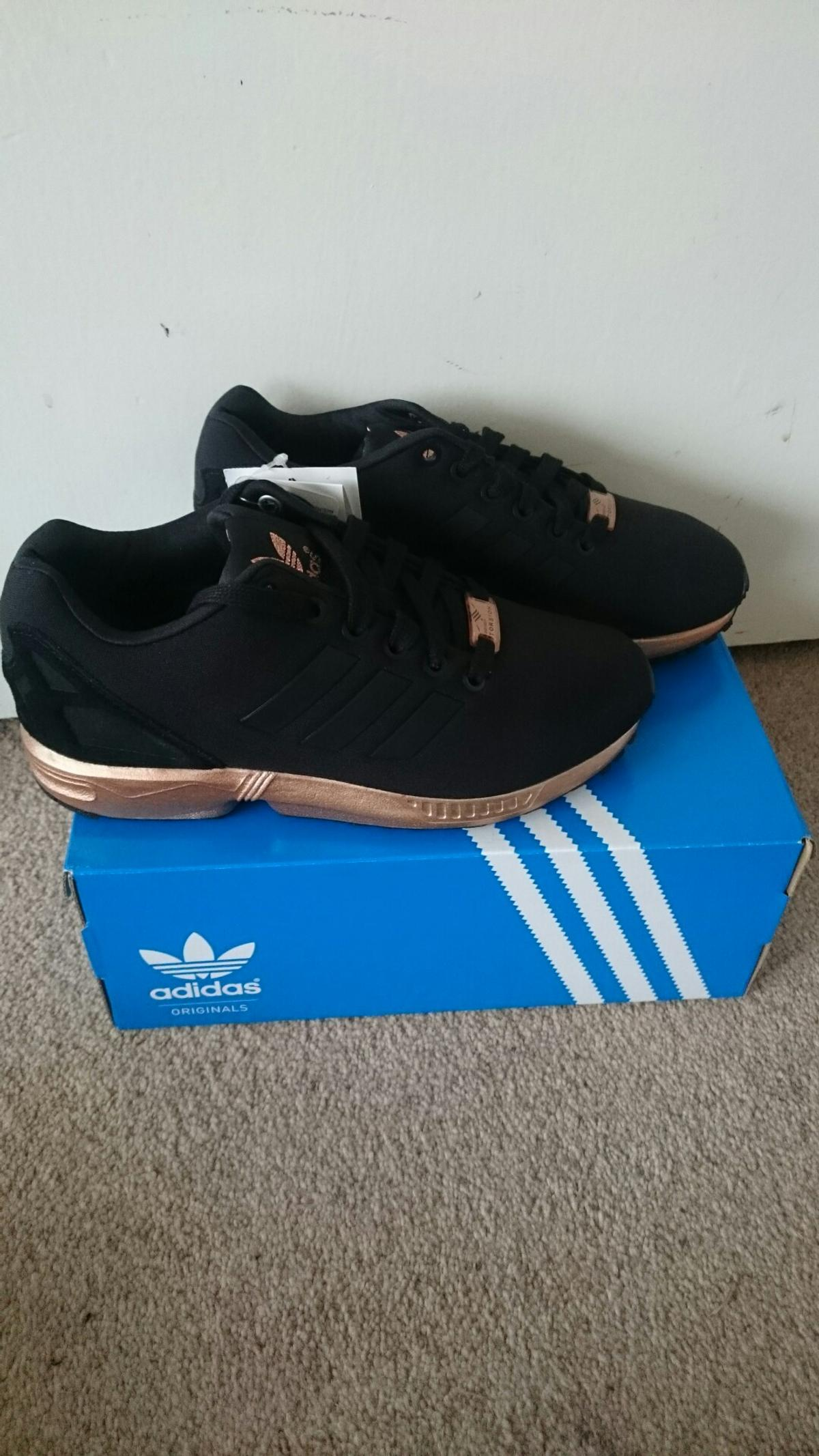 buy online d2e90 51d3f Adidas flux black with metallic copper/gold