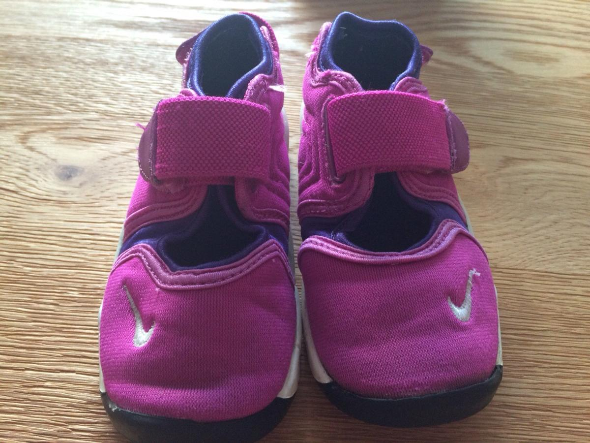 pretty nice c7ff2 1020c Description. A pair of Nike Rift Pink Purple Infant Girls Trainers.