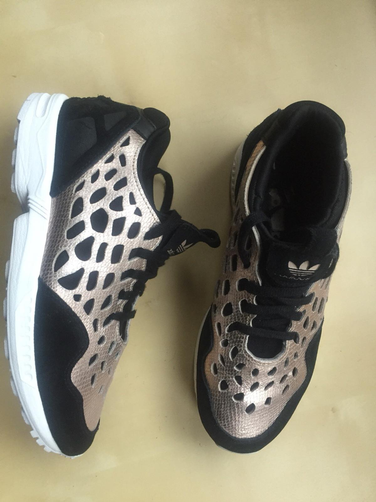 3c4ba992d Description. Stunning and much sort after Adidas ZX Torsion Flux Trainers  ...