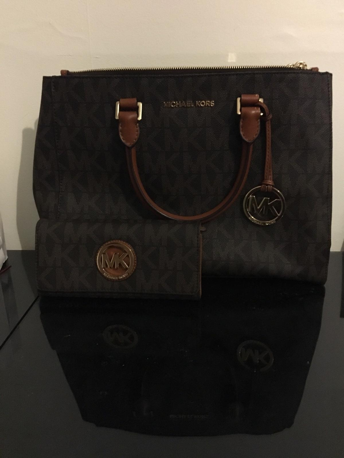 535083efc823 Description. Matching leather handbag and purse by Michael Kors selling ...