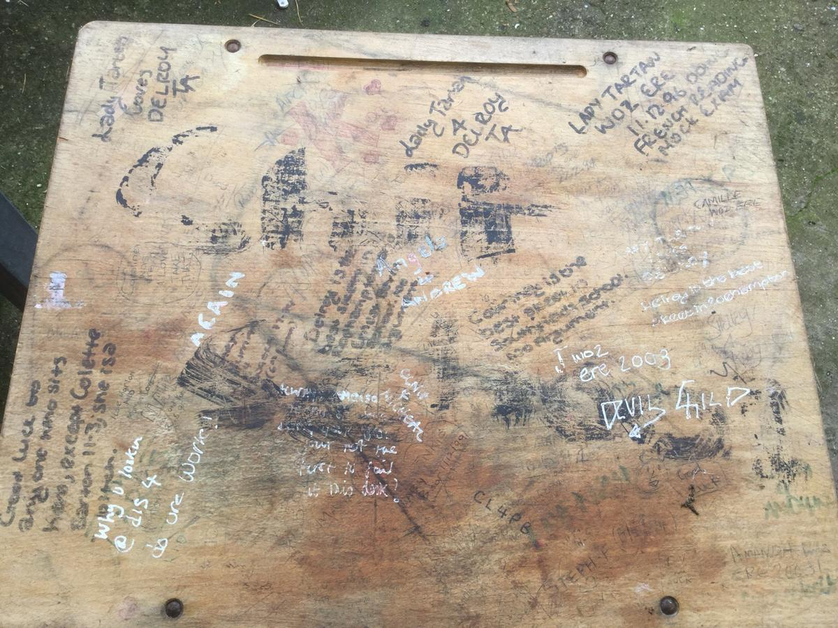 Desk old style with graffiti
