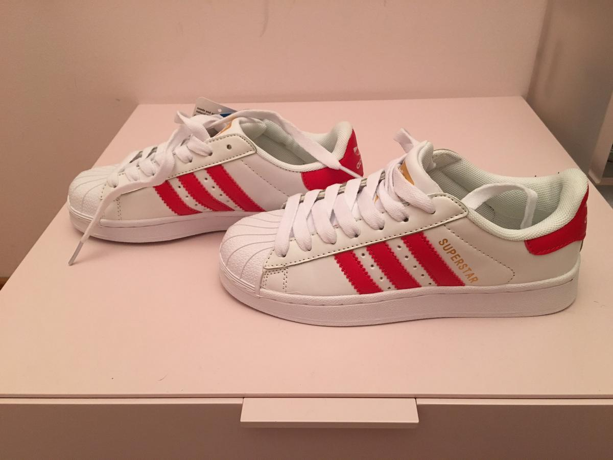 adidas bianche con strisce rosse