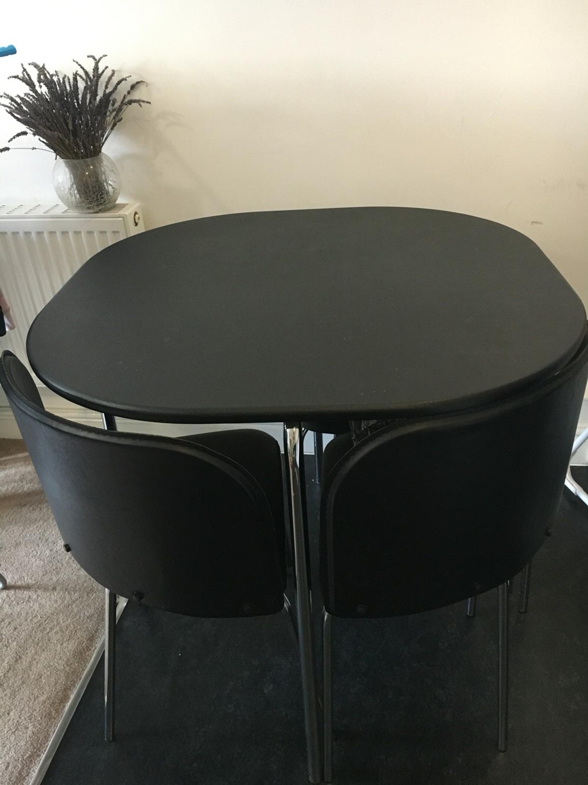 Black Stowaway Dining Table And Chairs