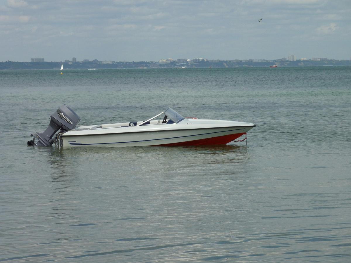 Fletcher speedboat and 70hp Johnson outboard in PE28