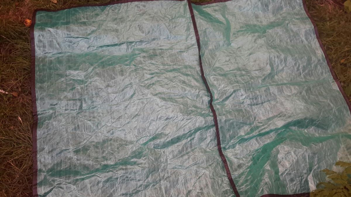 Green plastic sheet, cover for camping etc