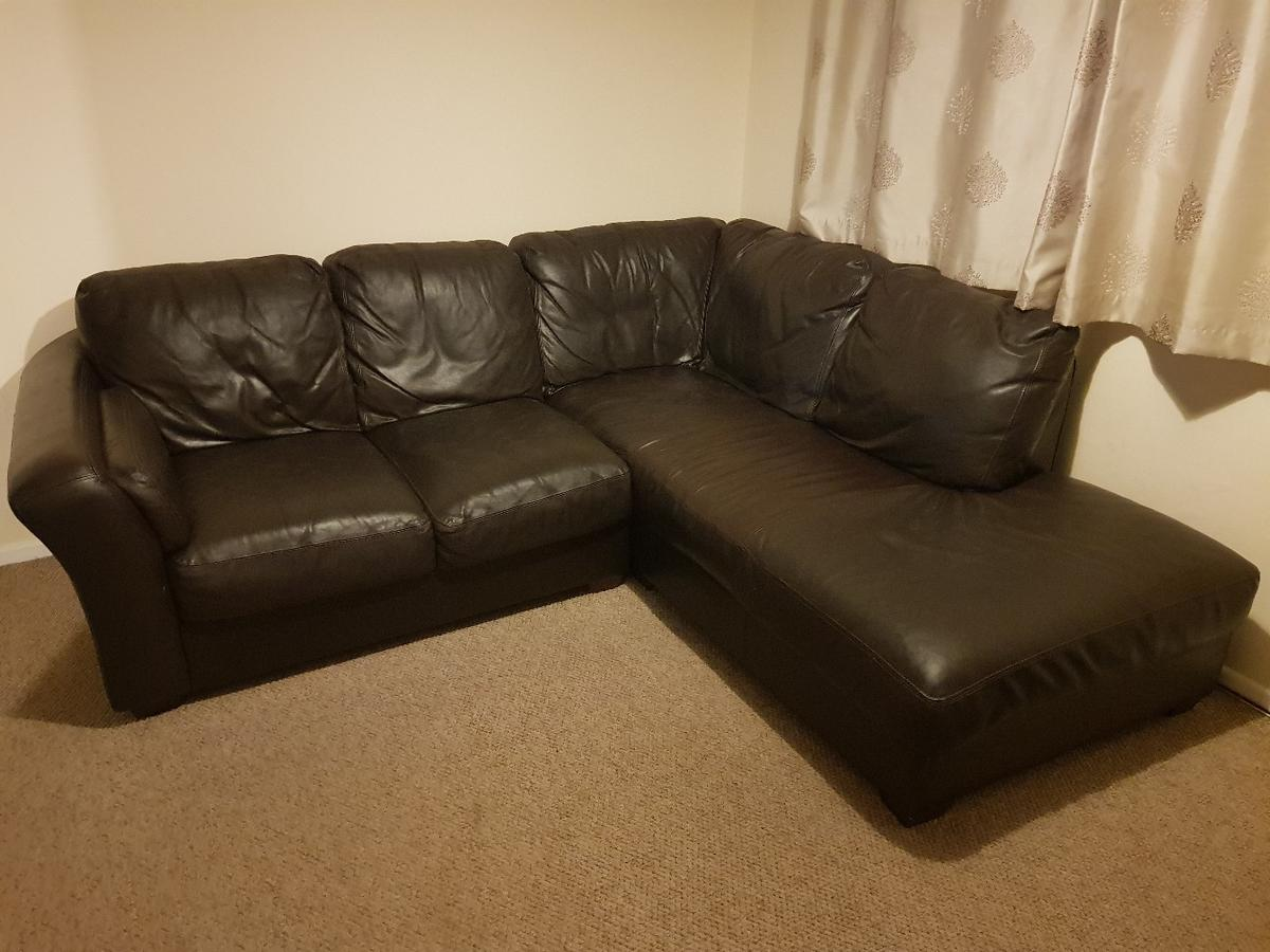 Black leather L-shaped sofa