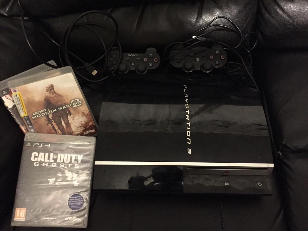 Sony PS3 PlayStation 3 bundle 2 pads 8 games