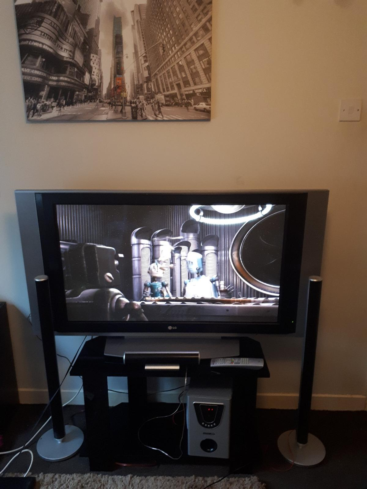LG 42inch Plasma TV, Sound System, TV stand in St Helens for