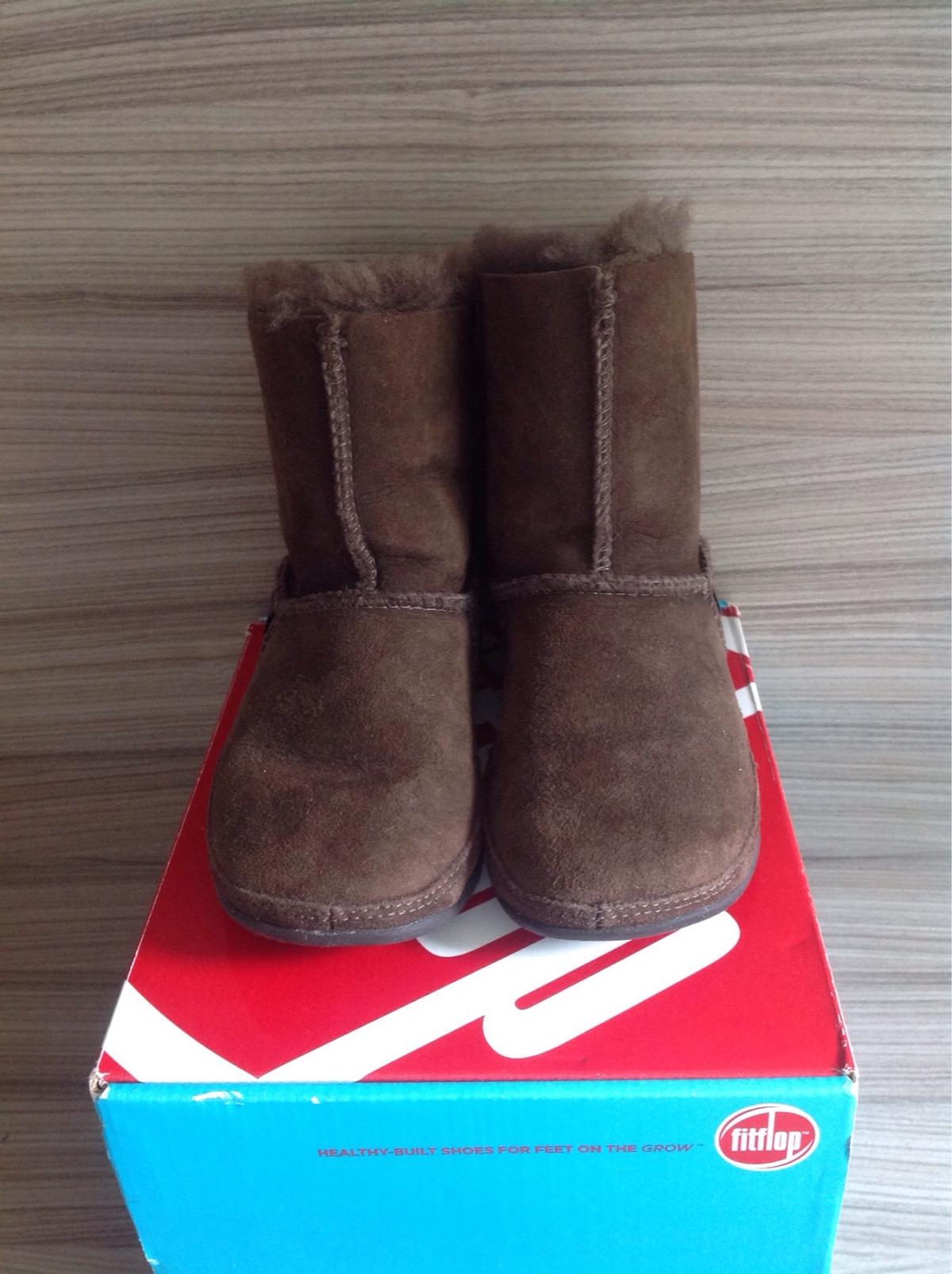 4fbb0324a Description. Fitflop Kids Mukluk Wobble Board Brown Suede pull on ankle  boots. UK