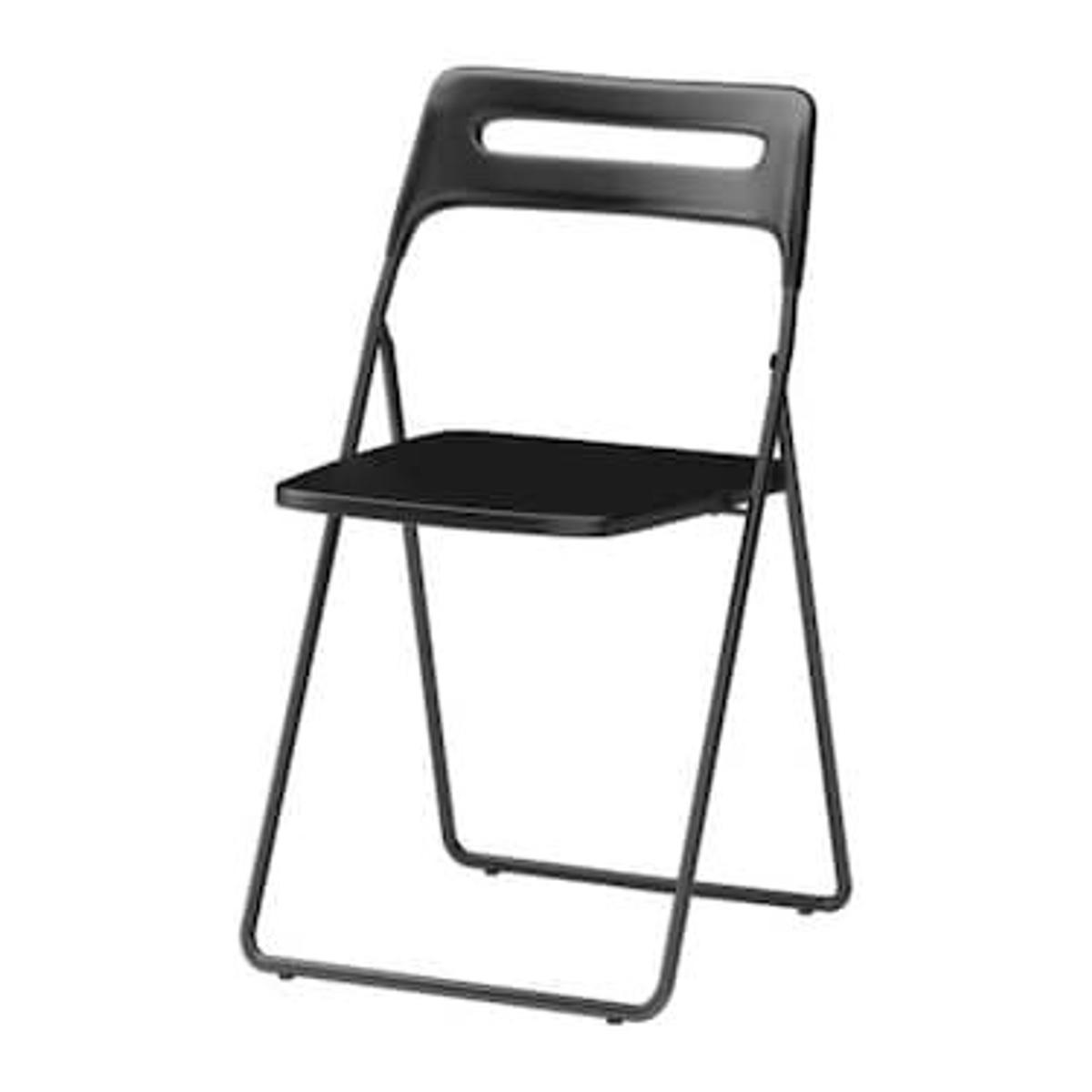 Two Black Folding Chairs From Ikea Nisse