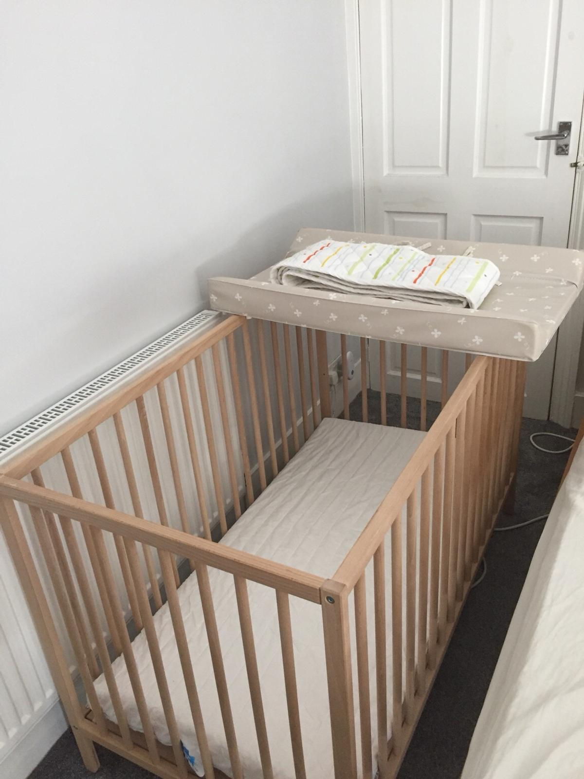 Baby cot with mattress and changing mat