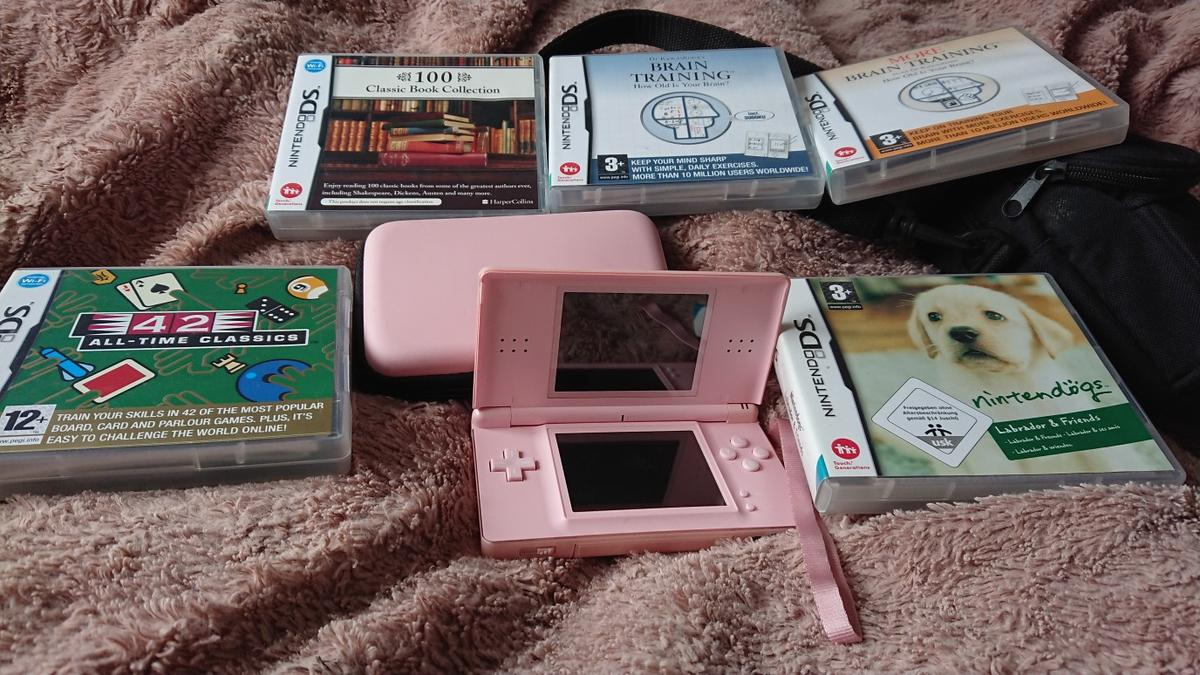 nintendo pink dslite with 5 games in Packmoor for £40 00 for sale