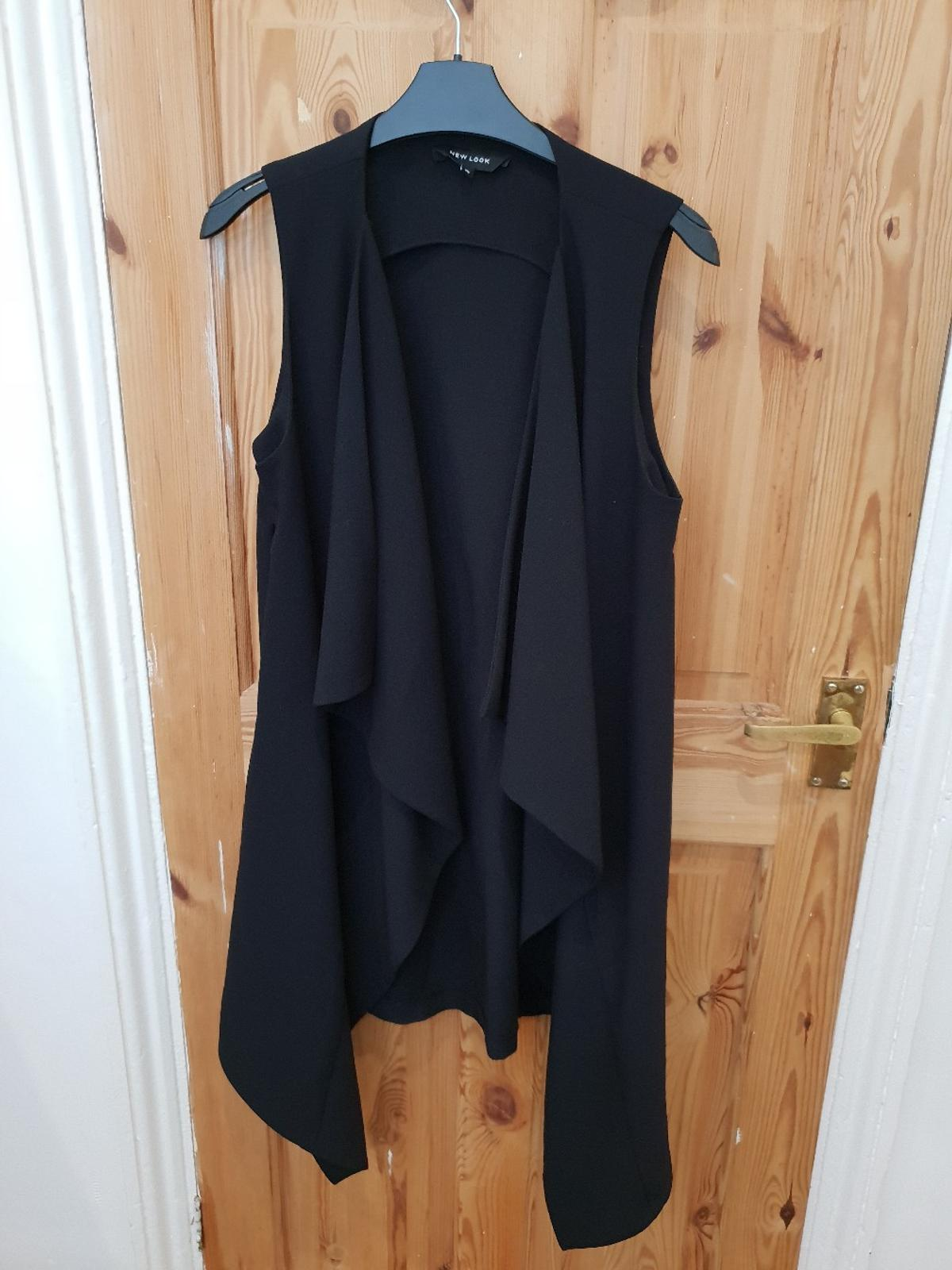 c0ae7ed15bd30 Description. New Look Black Duster Jacket Sleeveless Size 10. Waterfall  style on the front