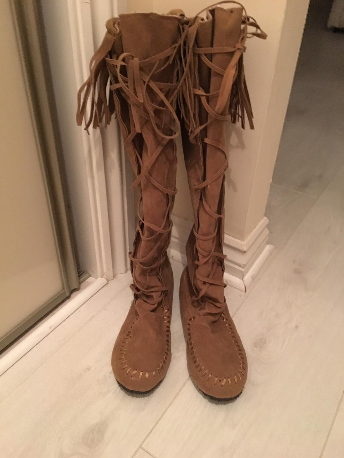 Brown moccasin boots size 4