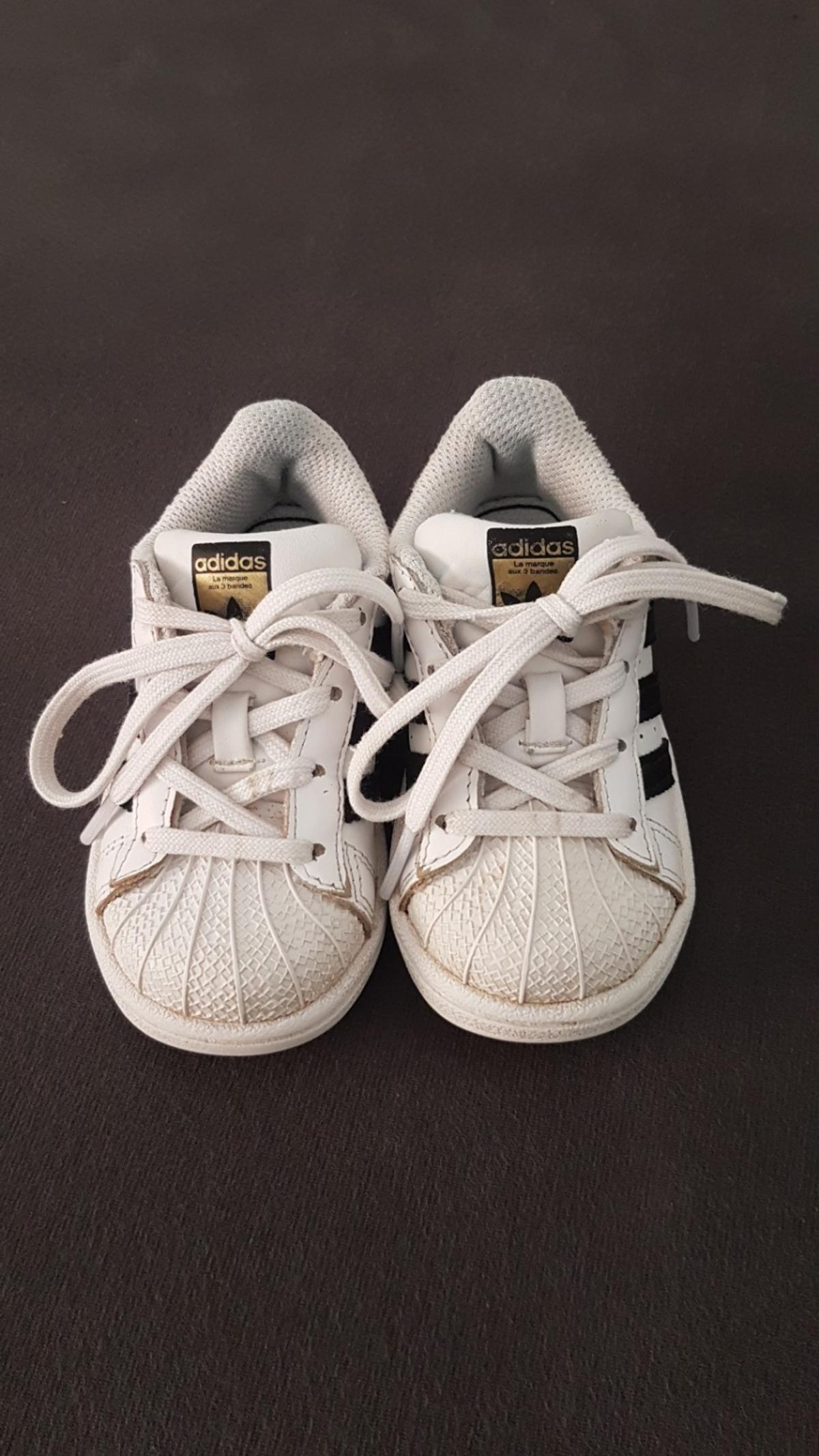 cool white adidas sneakers