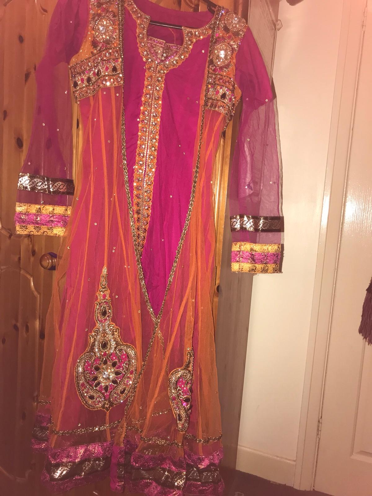 This outfit very suitable for mehndi has beautiful embroidery work on this outfit colour is fascinating. Size 12