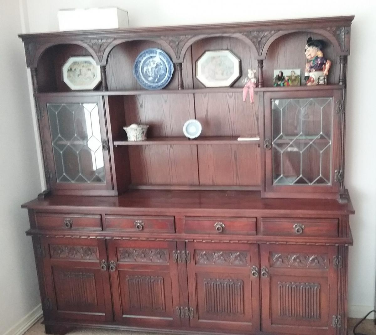 "Beautiful dark oak ""Old Charm"" tudor rose dresser, great condition, glazed windows plate racks, cupboards and drwers so plenty of storage cost over £1000 to buy new, lovely piece of furniture, now reduced to £400 grab a fantastic bargain"