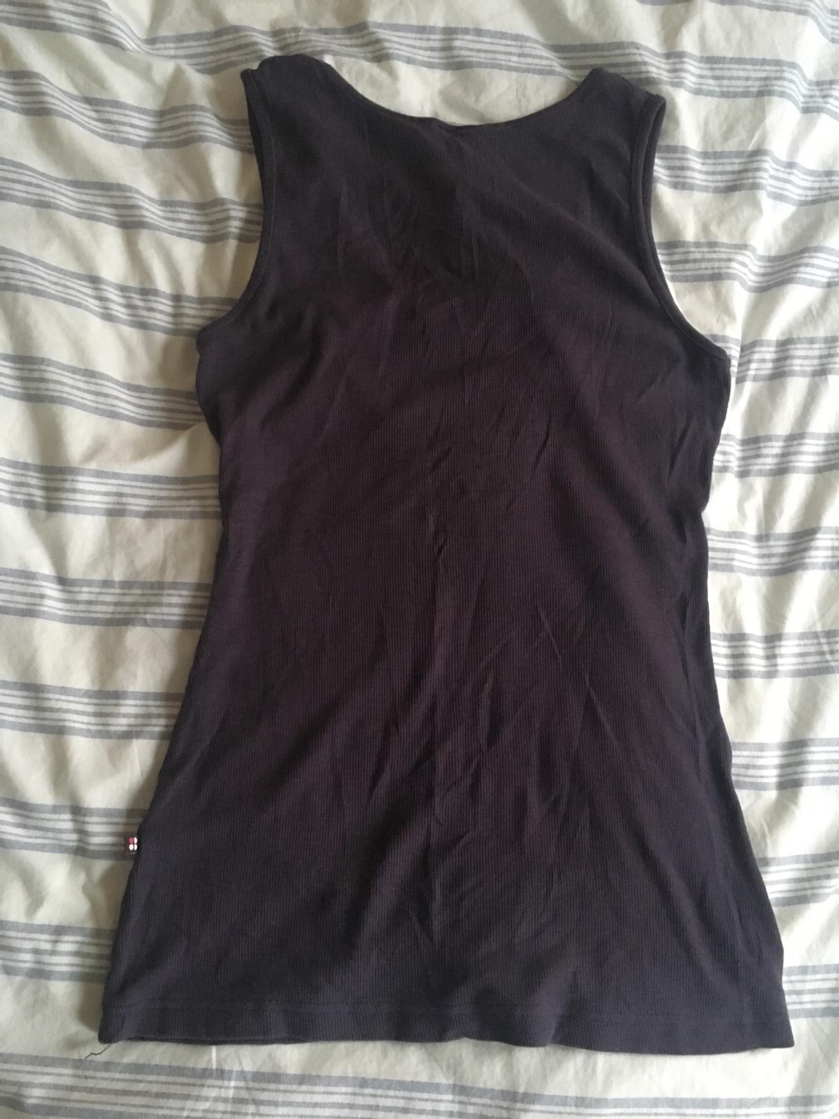 Sweaty Betty purple ribbed Yoga vest. Used, in very good condition. Can post in UK for additional £3.00