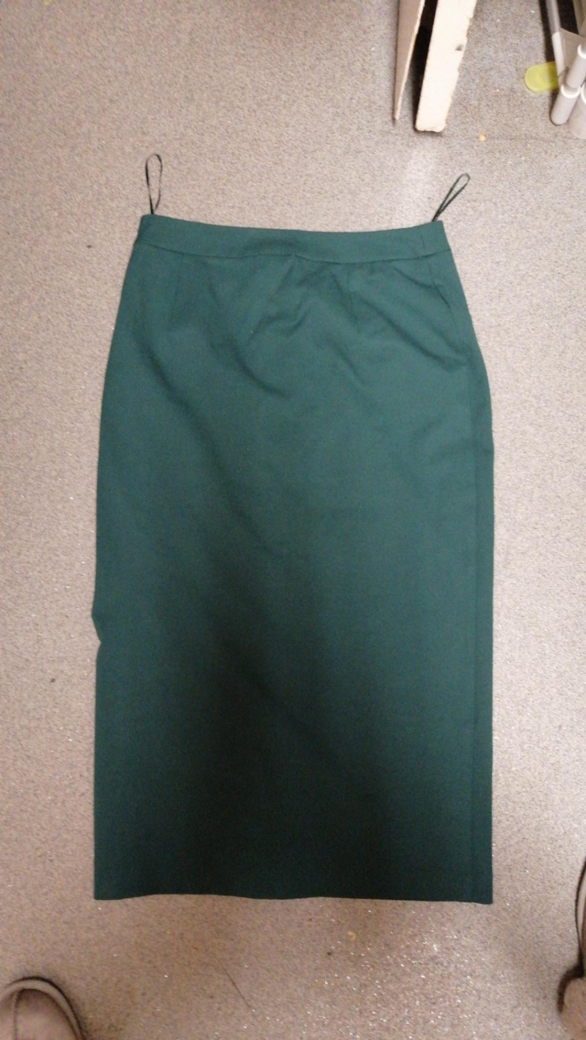ladies m&s emerald green A-line skirt with metal fake buttons down the front still with tag on never worn size 12 rrp£39.95