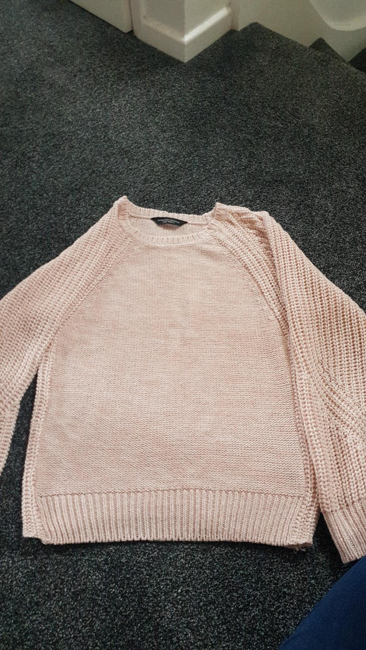 size 10 pink jumper from a pet free and smoke free home. washed and ironed