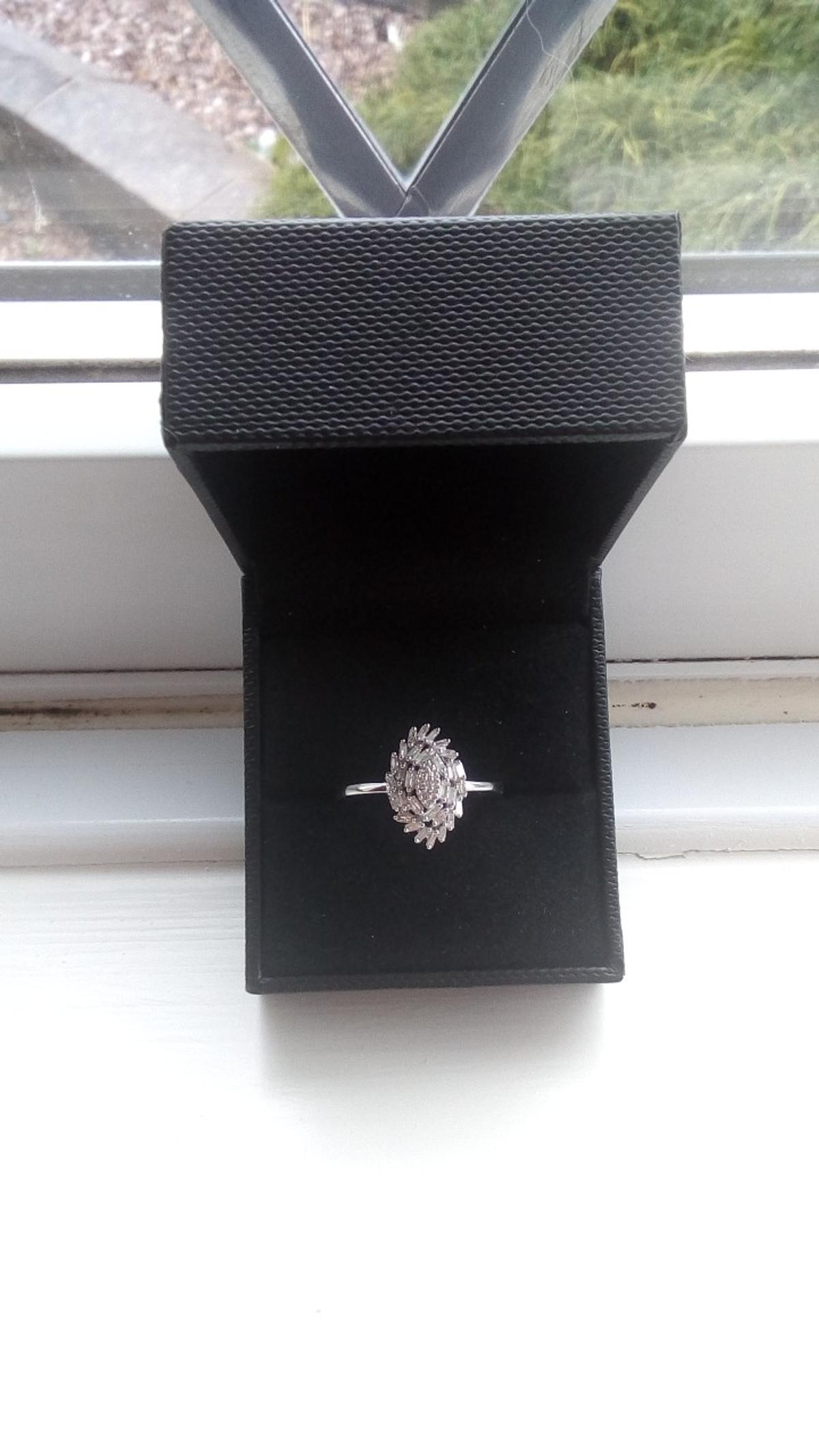 white gold bagette diamond ring 1/4 of a carrot has 32 bagette diamonds size n- o you can have it sized up or down would be a lovely engagement ring bought for £500.
