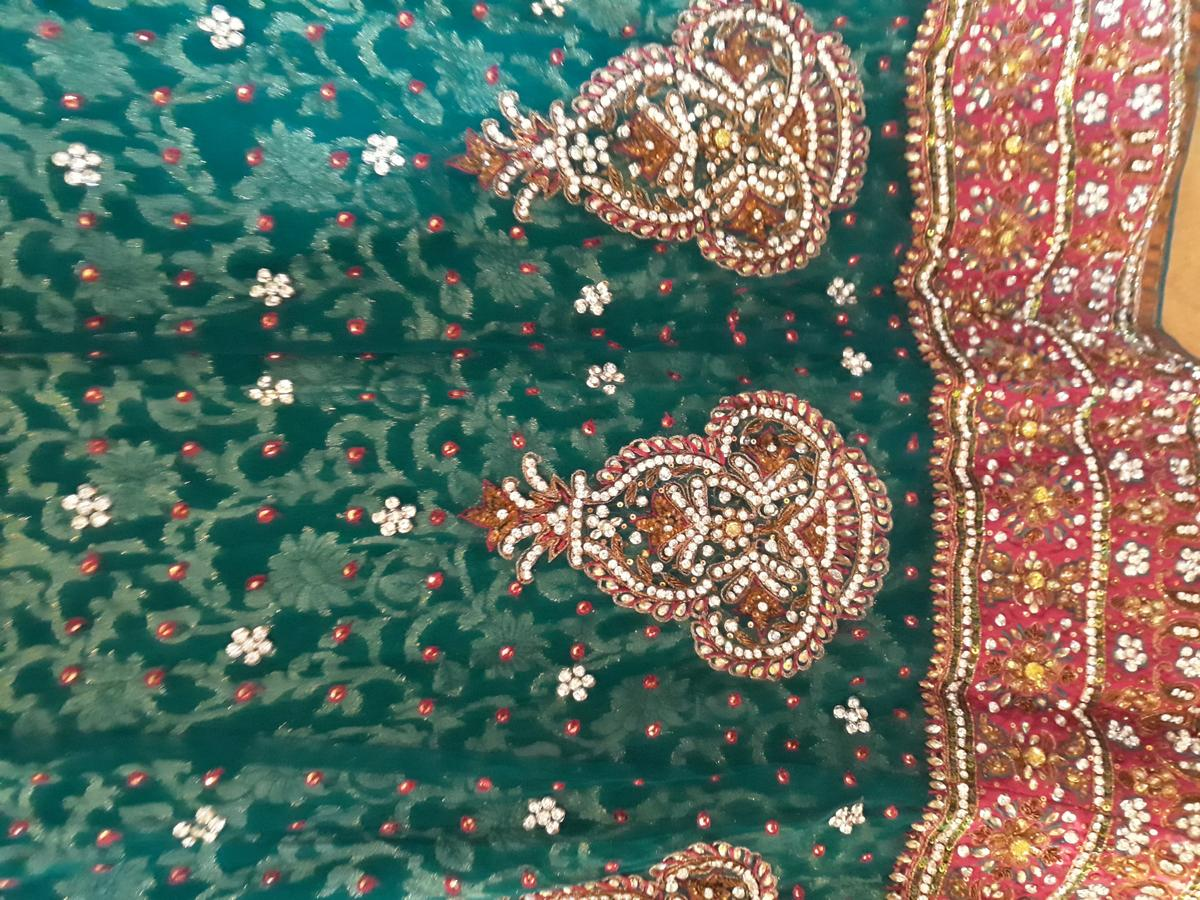 The Lehenga is an Original Design . The shades may vary slightly from the colors displayed on your screen. There might be slight color variation due to lightings & flash while photo shoot. The bright shade seen is the best closer view of fabric's color.