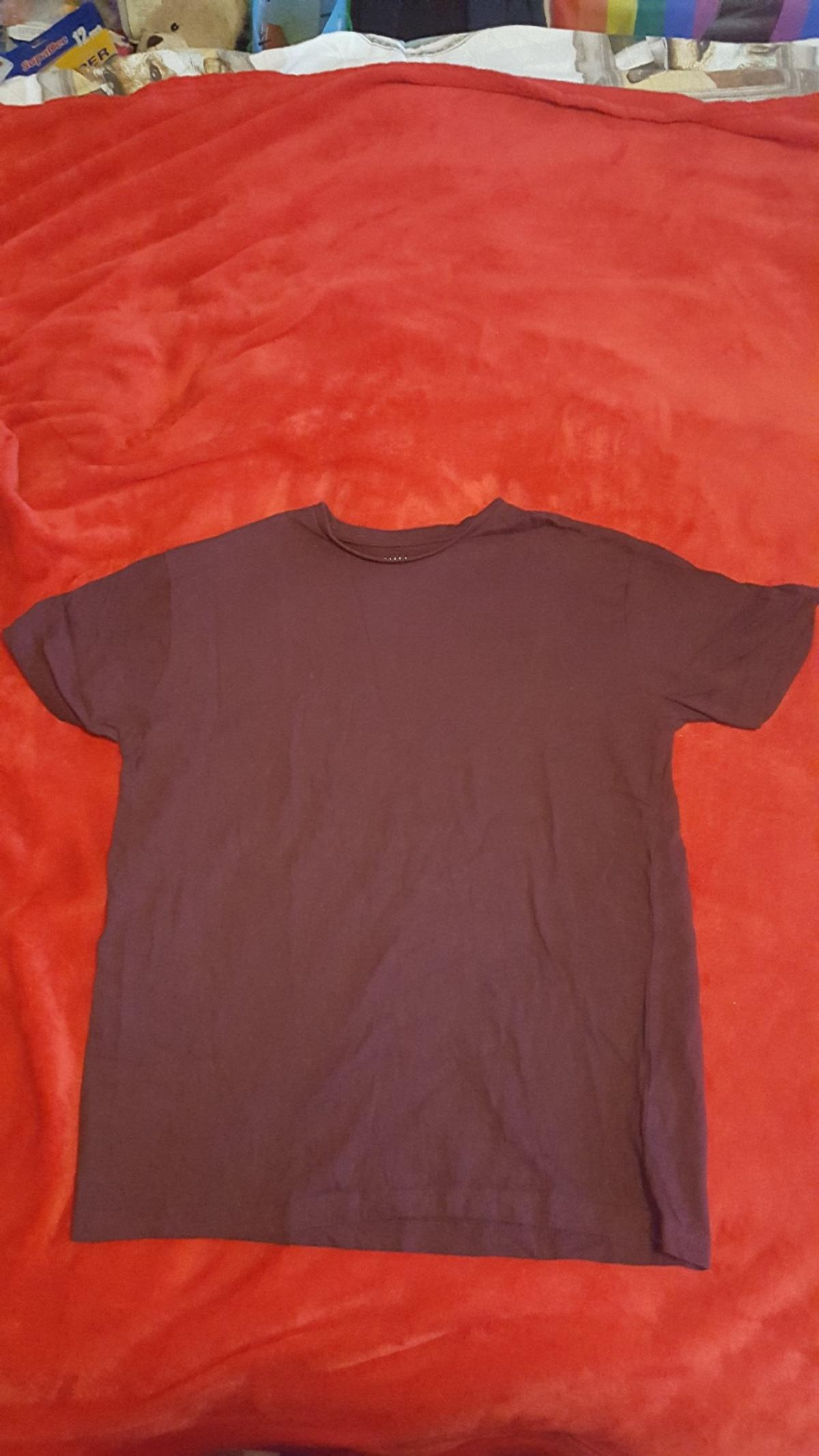 Size XS t-shirt from Primark. Dark red all over (no pattern/design). Has been worn, but is washed and in good condition.