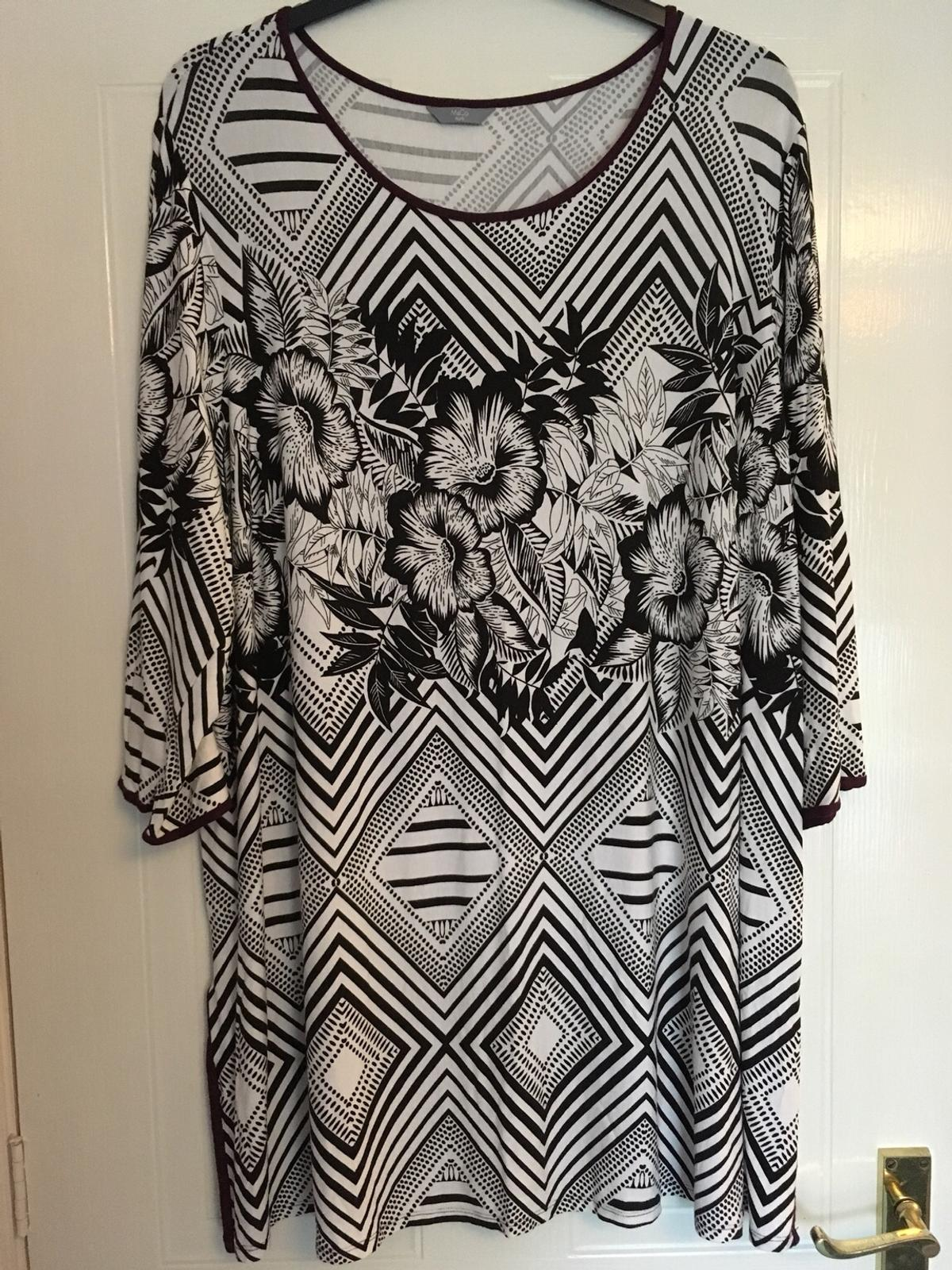 M & Co size 26 tunic top with 3/4 length sleeves in black/white print with purple trim round collar and edges. Very good condition, postage to be added