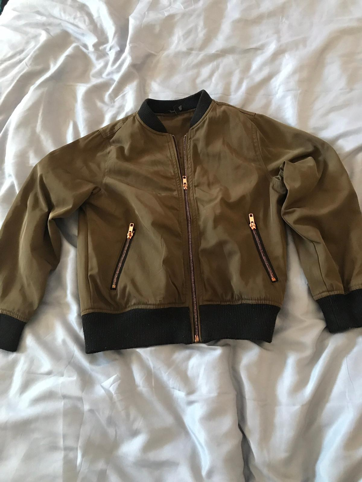 Age 10 jacket (khaki) Hardly worn