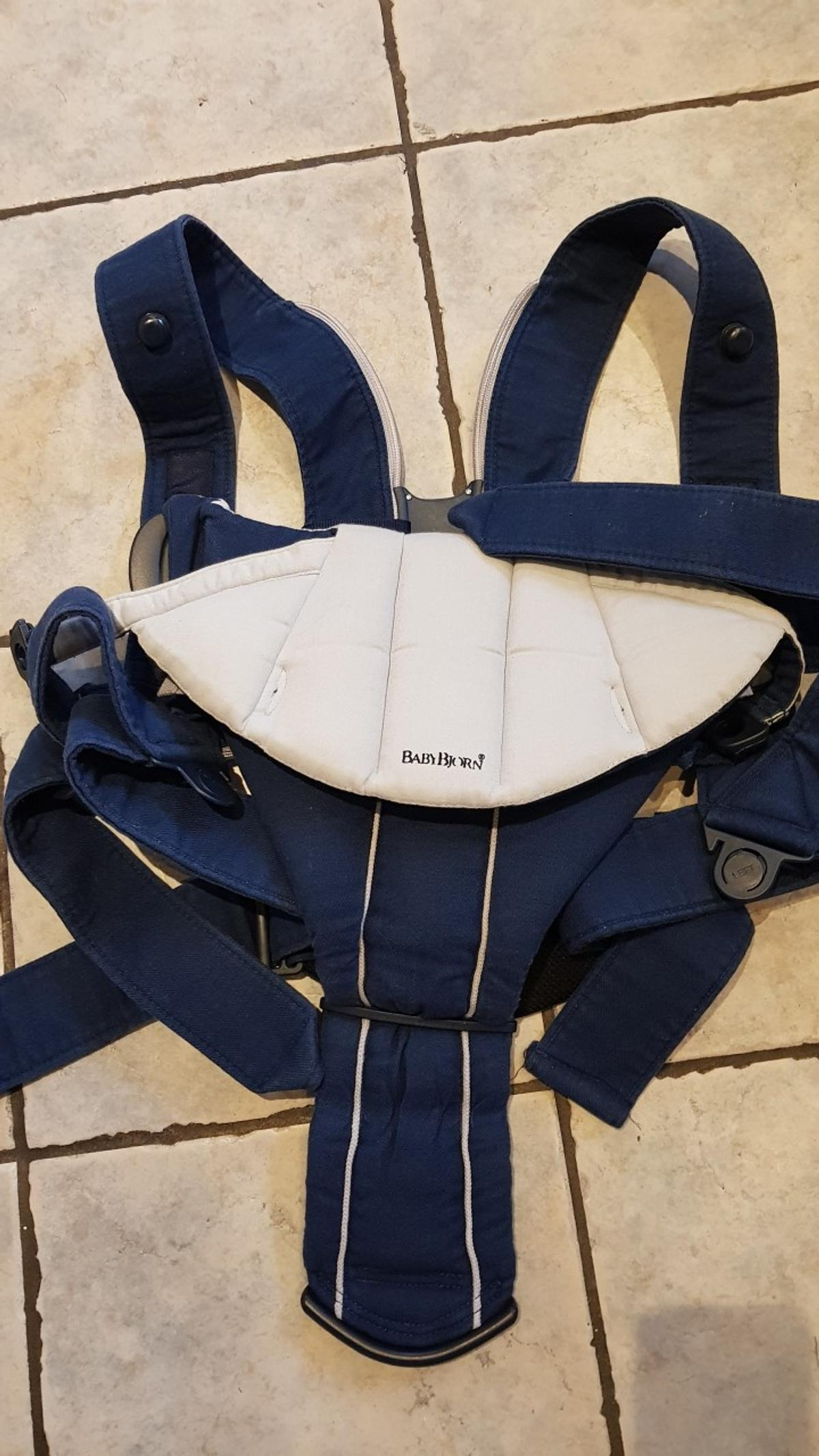 blue baby carrier from birth to carry front and back from older. good condition