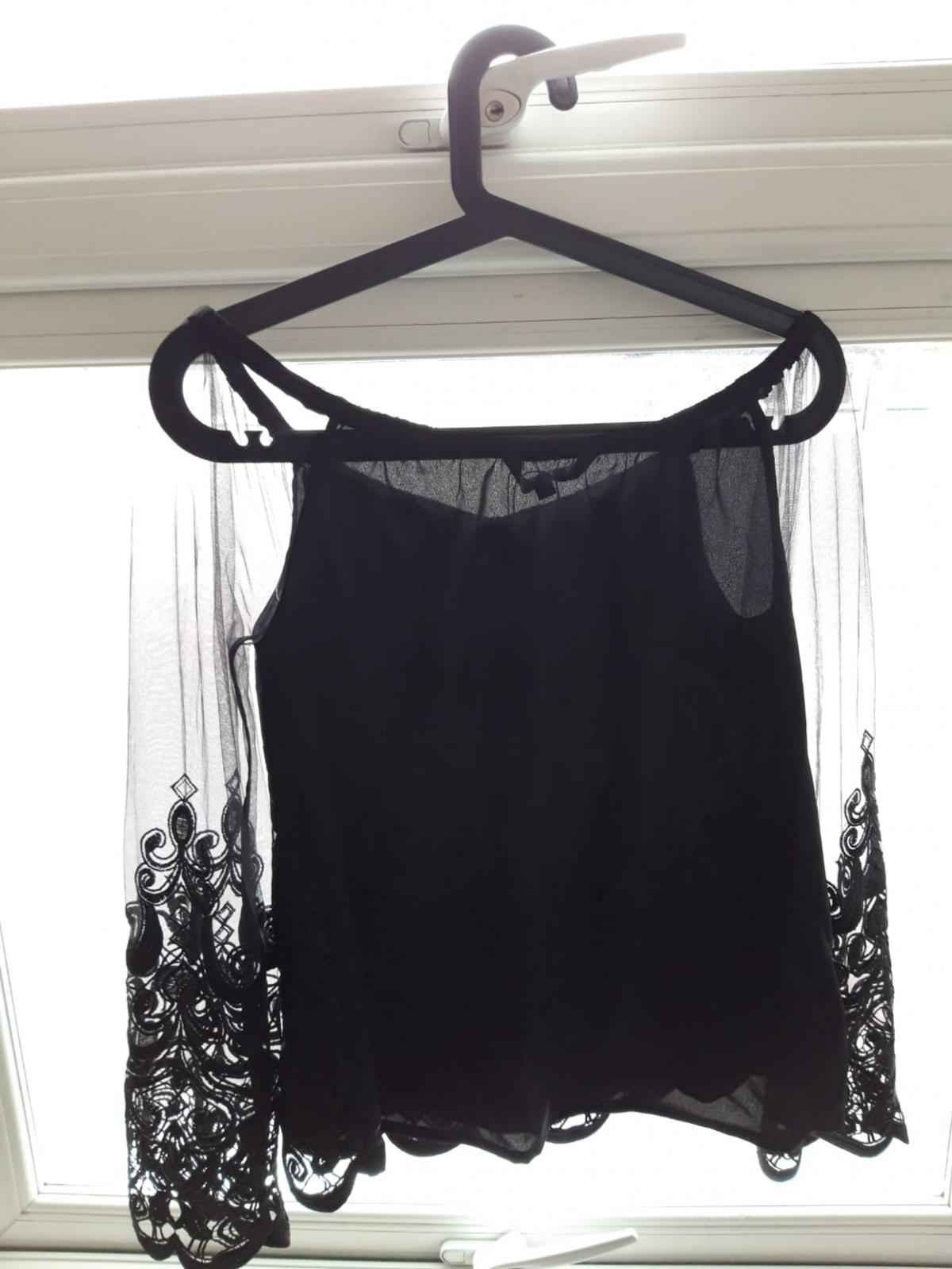 Brand new top. Made of mesh and embroidery. Size 10. From pet and smoke free home. Collection from Wallington area.
