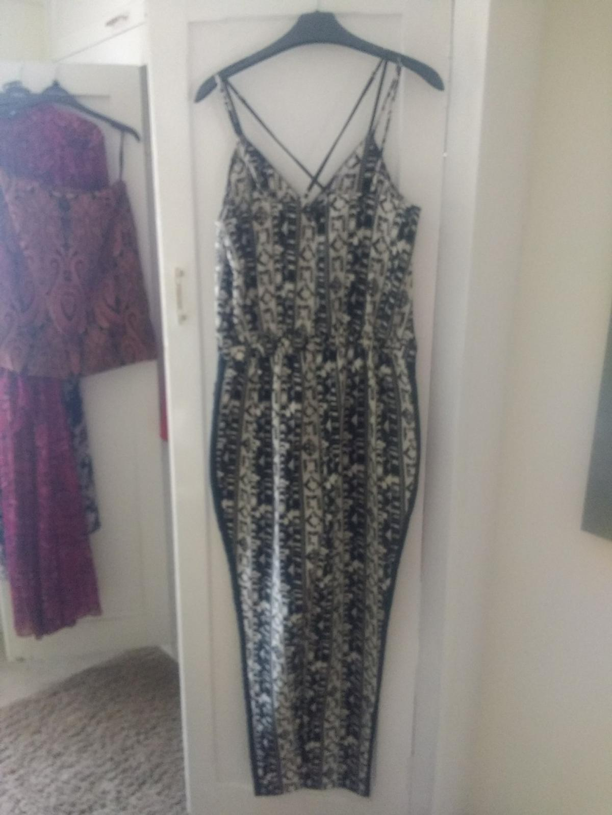 black and white jumpsuit with satin side leg trim, size 10 purchased from Next. excellent condition.