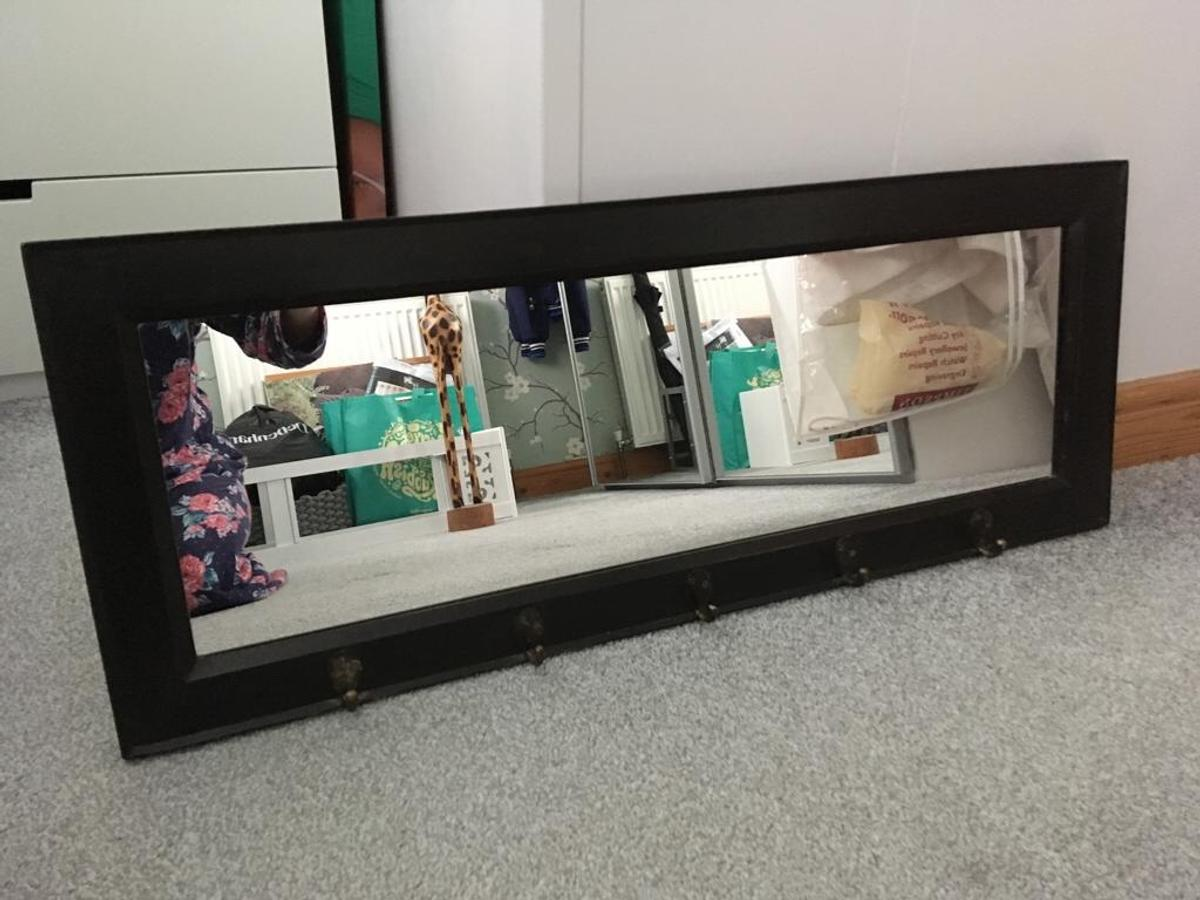 Dark wood mirror with 5 hooks for hanging keys/coats etc.  size-92x37cm
