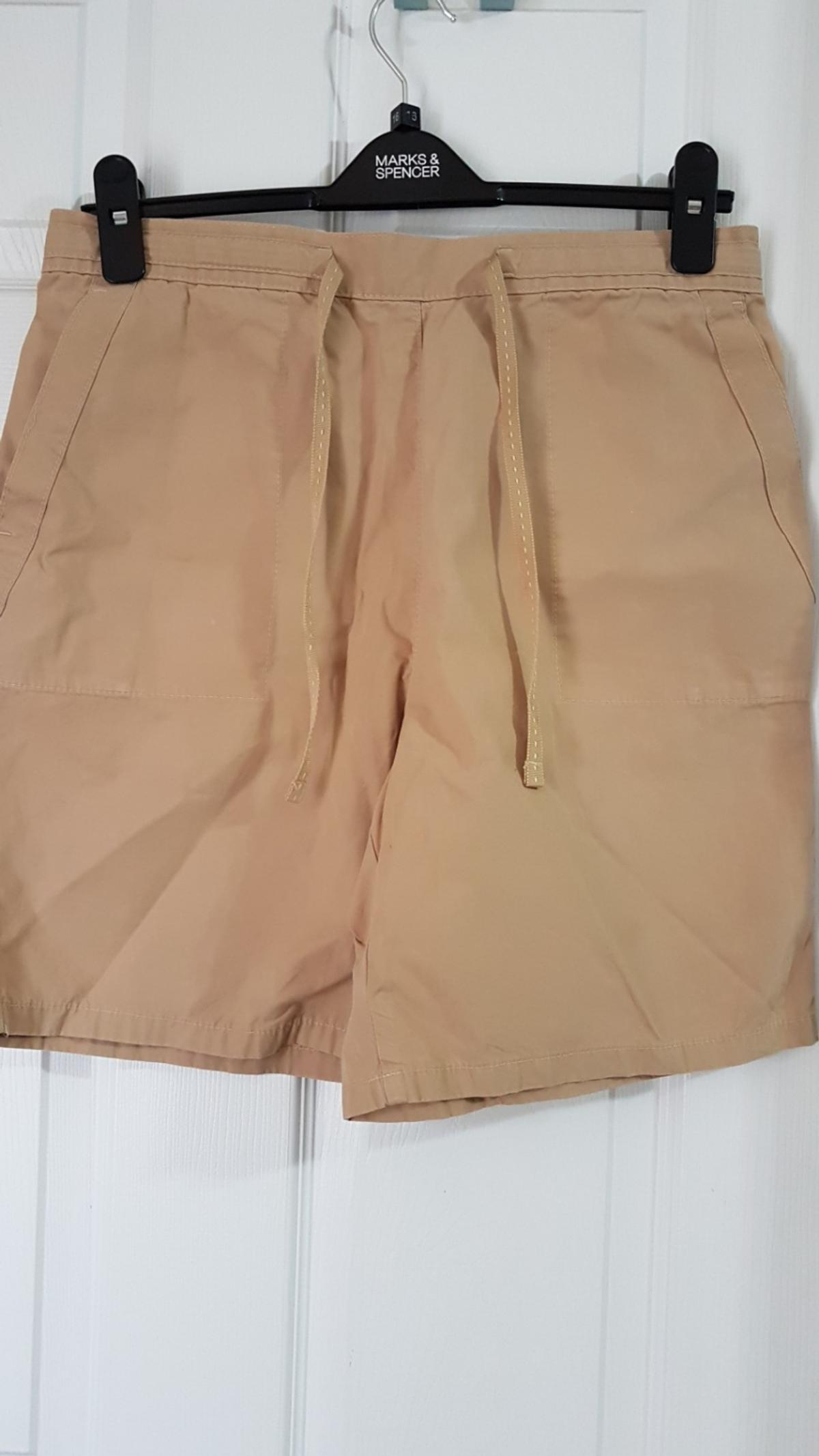 """Brand new never worn ladies """"Marks & Spencer beige shorts, elasticated back waist band, pockets to back & front. size 12. none smoking pet free home Collection Eastwood Leigh on sea or post tracked pay pal pls for this £2.95"""
