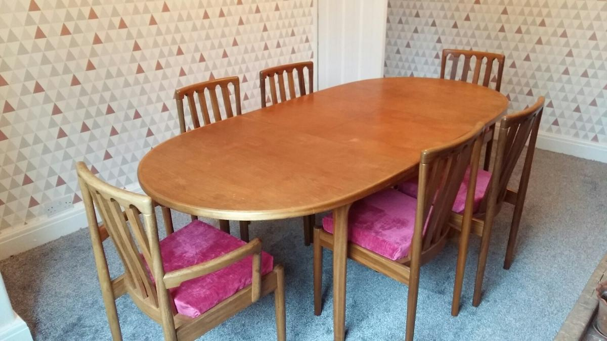 Vintage dining table by Mcintosh. Includes two carver chairs, all seats recently recovered in British velvet.