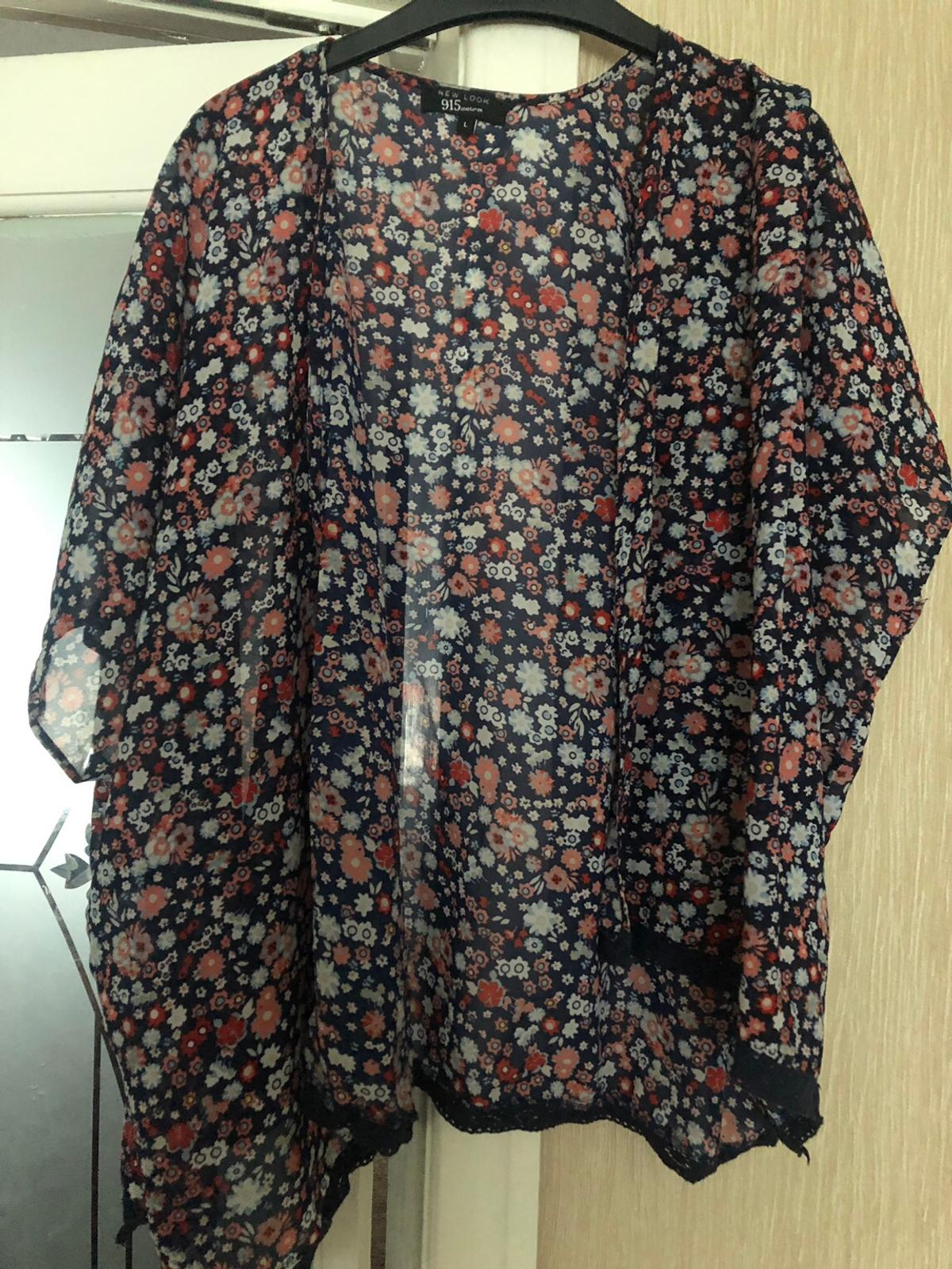 A girls large new look floral kimono. Worn once