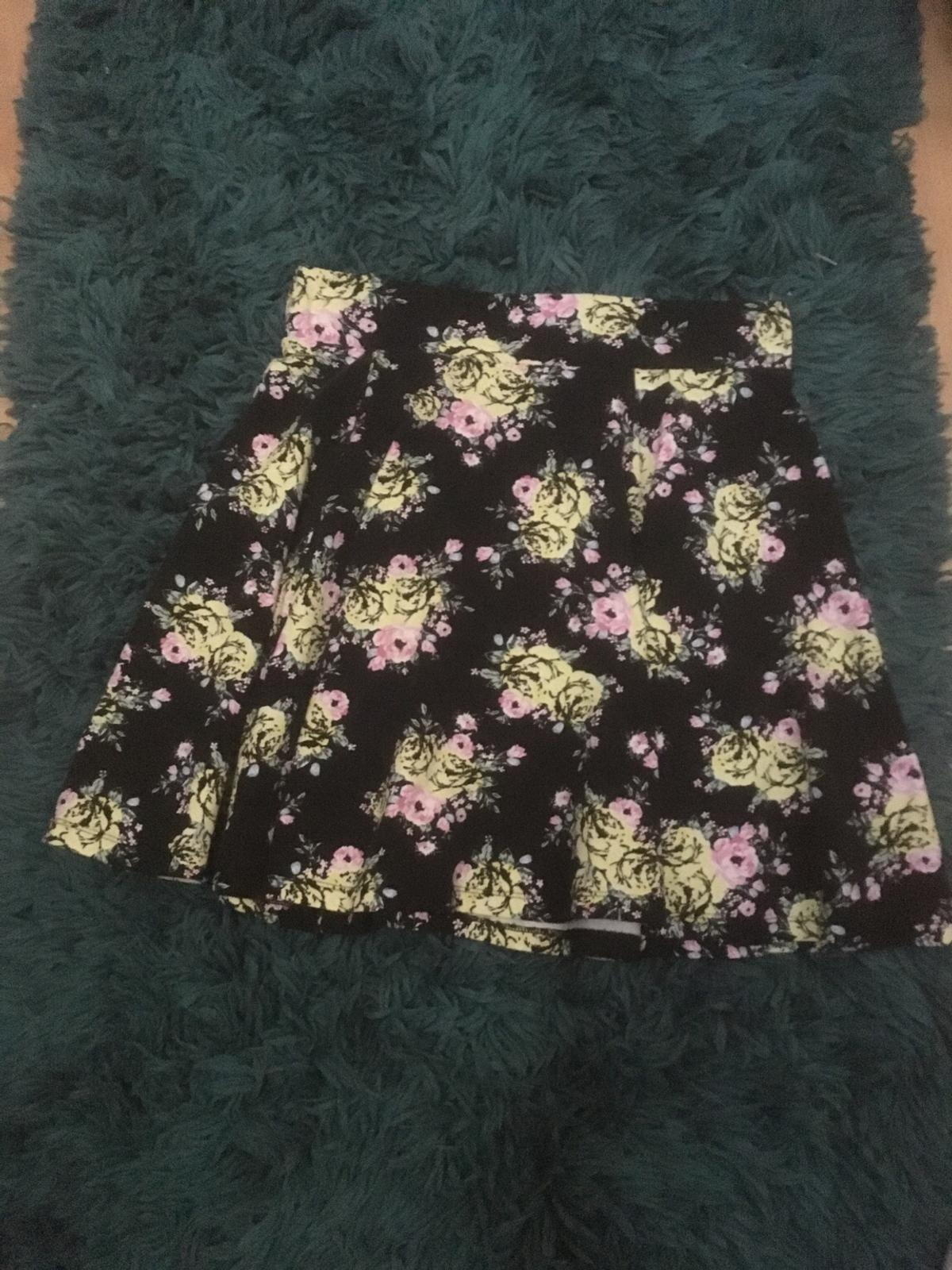 Pattern: yellow,pink,green flower Main-colour:Black Length:17Inches Size:14-15 also a elasticated waist Waist:14Inches
