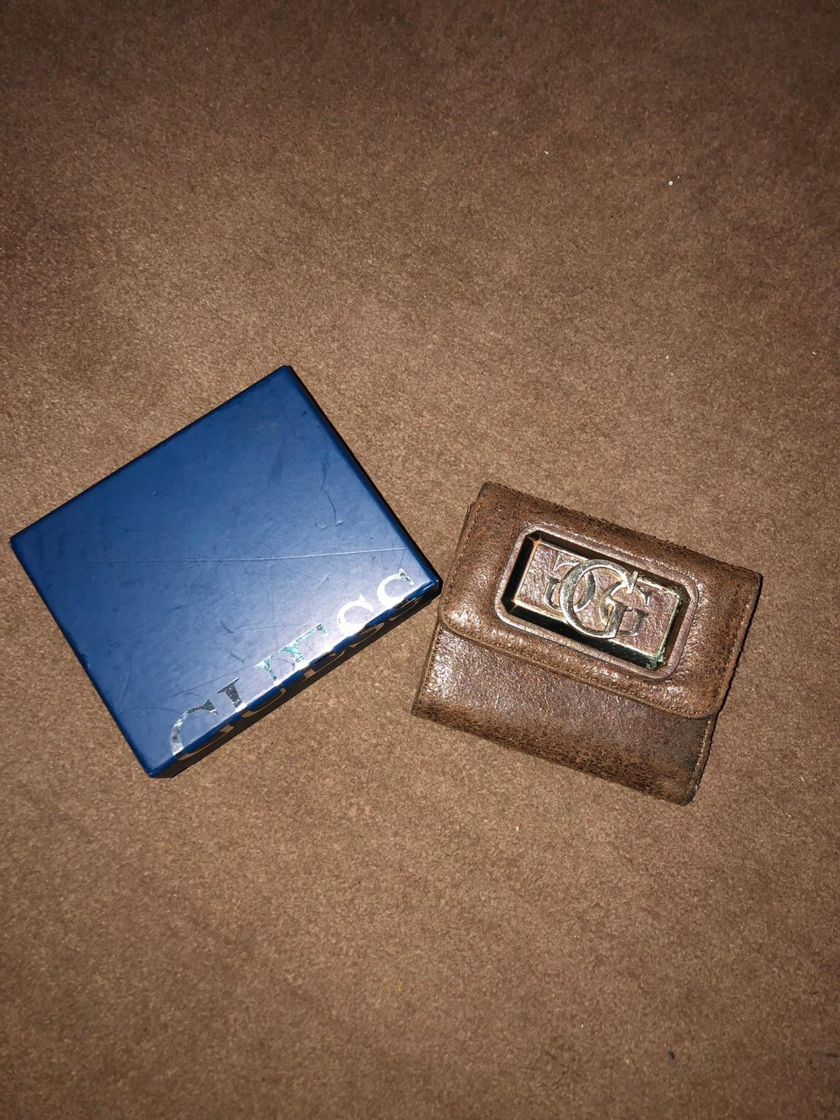 Brown suede effect small guess purse. Used but good condition. Collection only.