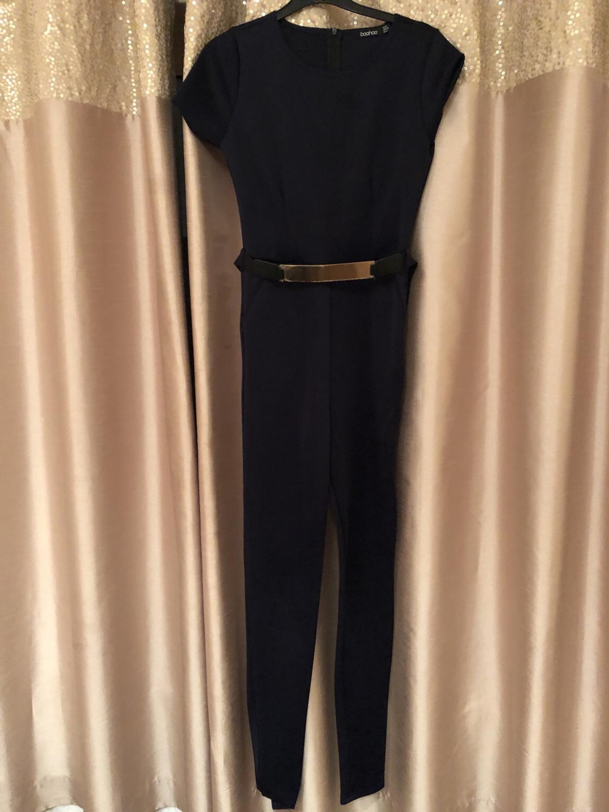 Full length tight fitting jersey material jumpsuit with gold belt. Size 8