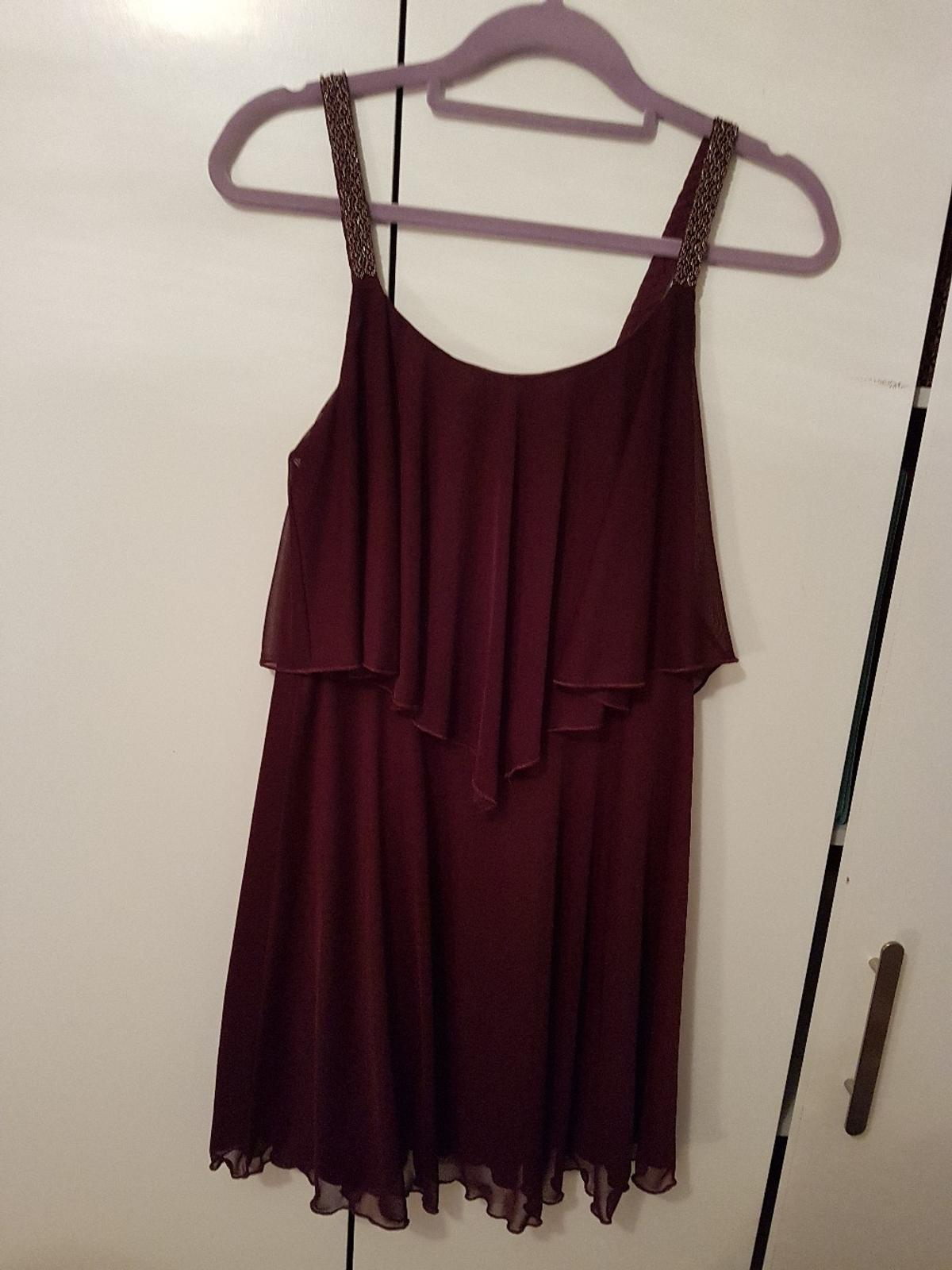 Purple new look dress with beaded straps. Size 12. Never worn, perfect condition. Can deliver.