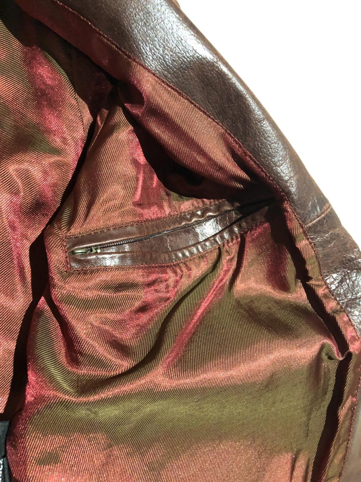 Great piece on sale - buy quickly as you'll not find such great distressed leather jacket.  Size L  Two inner pockets, inner lining perfect.  Great condition.